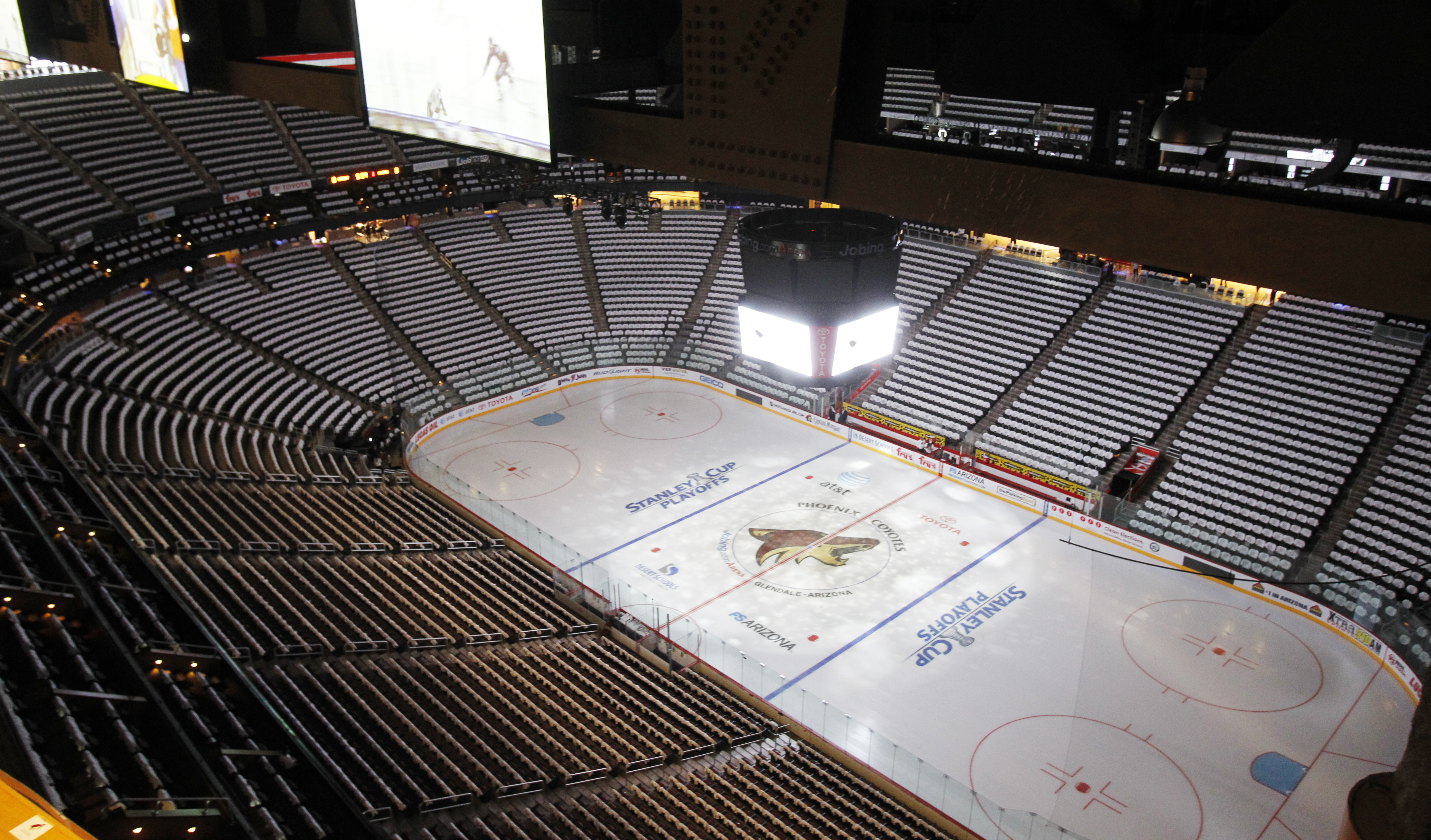 FILE - In this April 12, 2011, file photo, the Jobing.com Arena, home of the NHL hockey Phoenix Coyotes, sits empty before a Stanley Cup playoff game in Glendale, Ariz.   The city of Glendale has called for a special meeting on Wednesday, June 10, 2015, t