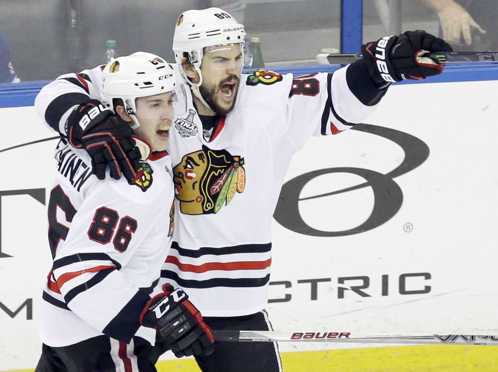Chicago Blackhawks center Antoine Vermette (80) celebrates with left wing Teuvo Teravainen (86) after scoring a goal against the Tampa Bay Lightning during the third period of Game 5 of the NHL hockey Stanley Cup Final, Saturday, June 13, 2015, in Tampa,