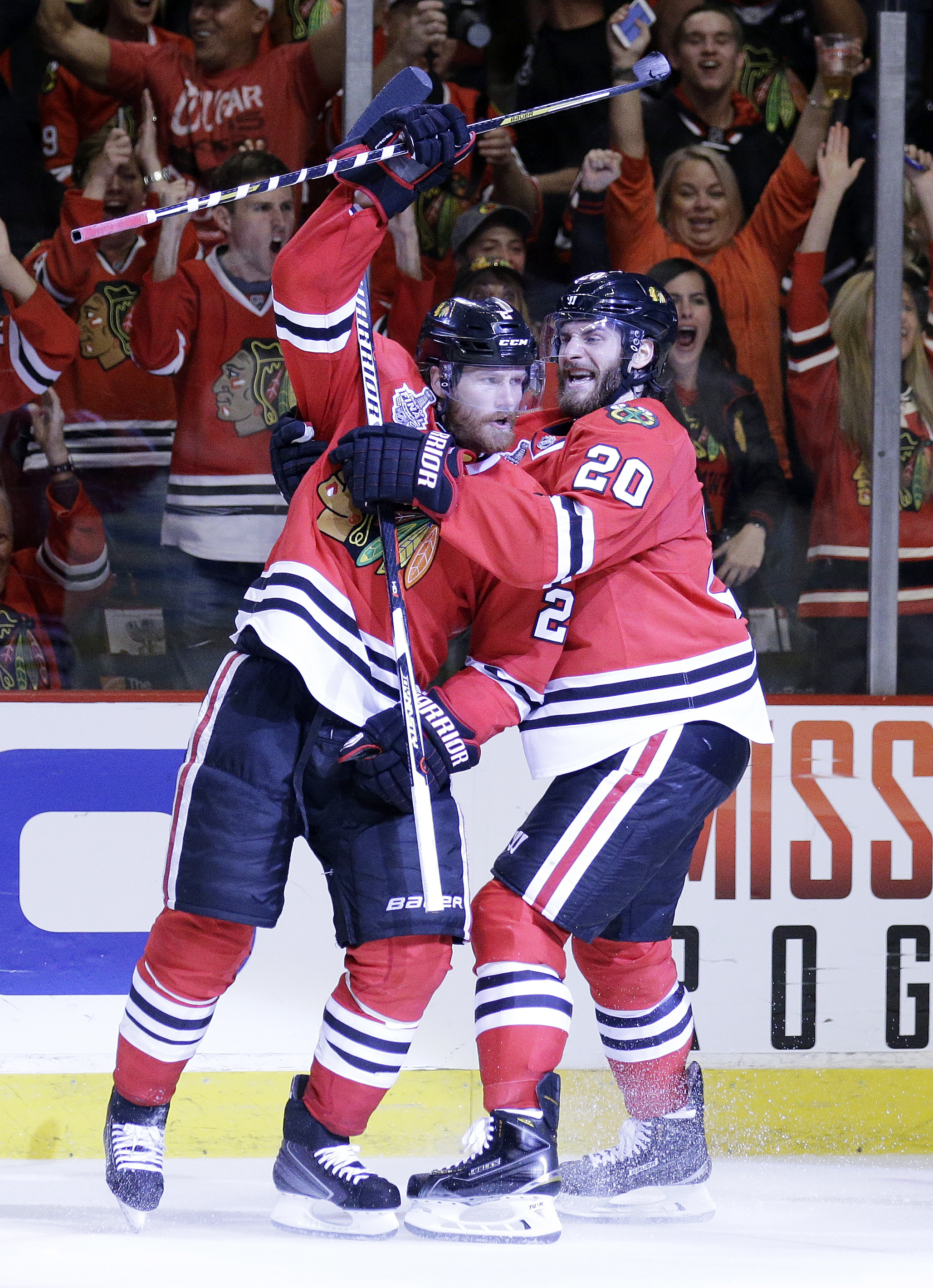 Chicago Blackhawks' Duncan Keith, left, is congratulated by teammate Brandon Saad after scoring a goal during the second period in Game 6 of the NHL hockey Stanley Cup Final series on against the Tampa Bay Lightning Monday, June 15, 2015, in Chicago. (AP