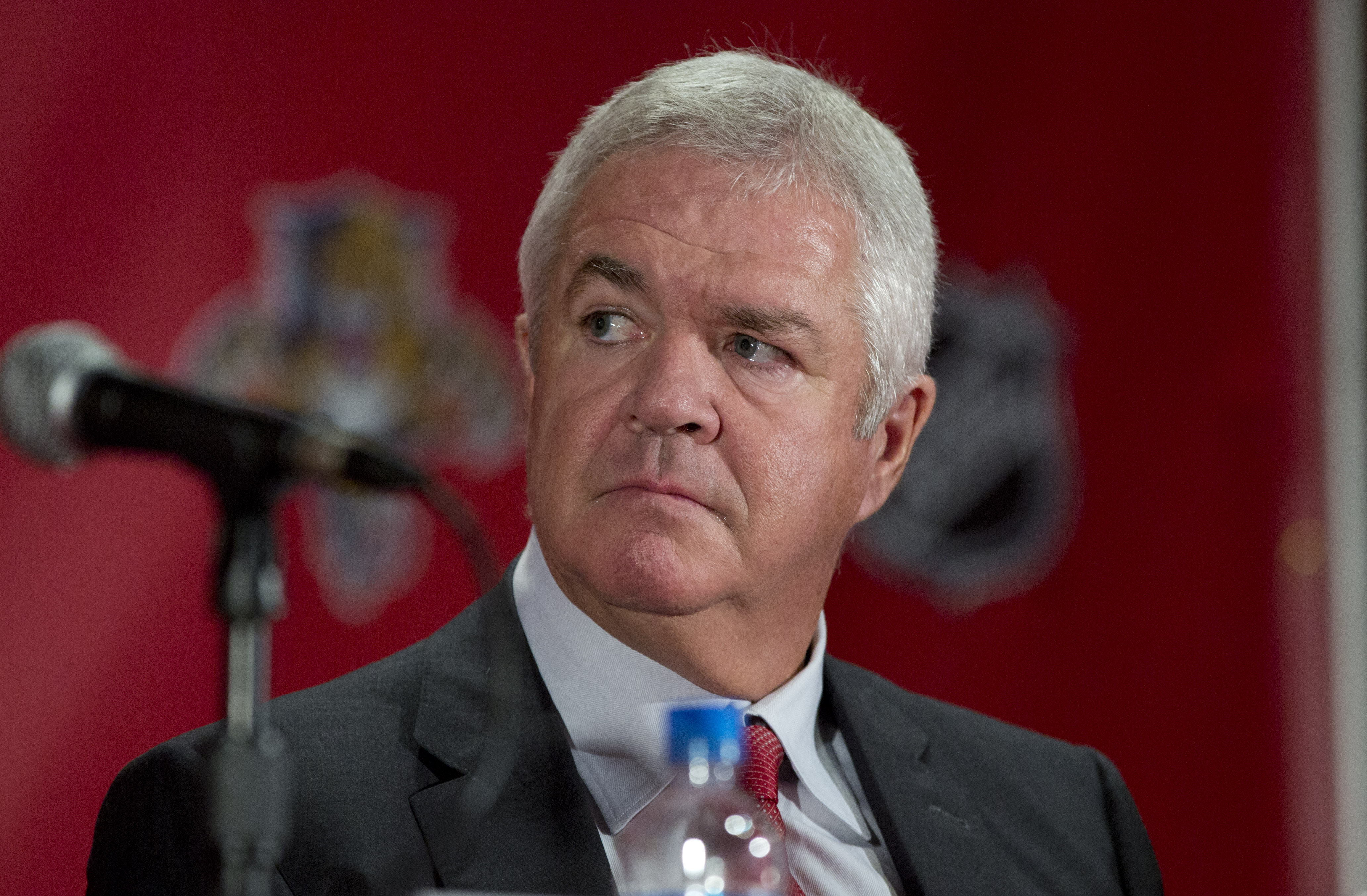 FILE - In this Sept. 27, 2013, file photo, Dale Tallon, the Florida Panthers' executive vice president and general manager, listens during an NHL hockey press conference in Sunrise, Fla. Much of the groundwork for Chicago's run as the NHL's dominant team,