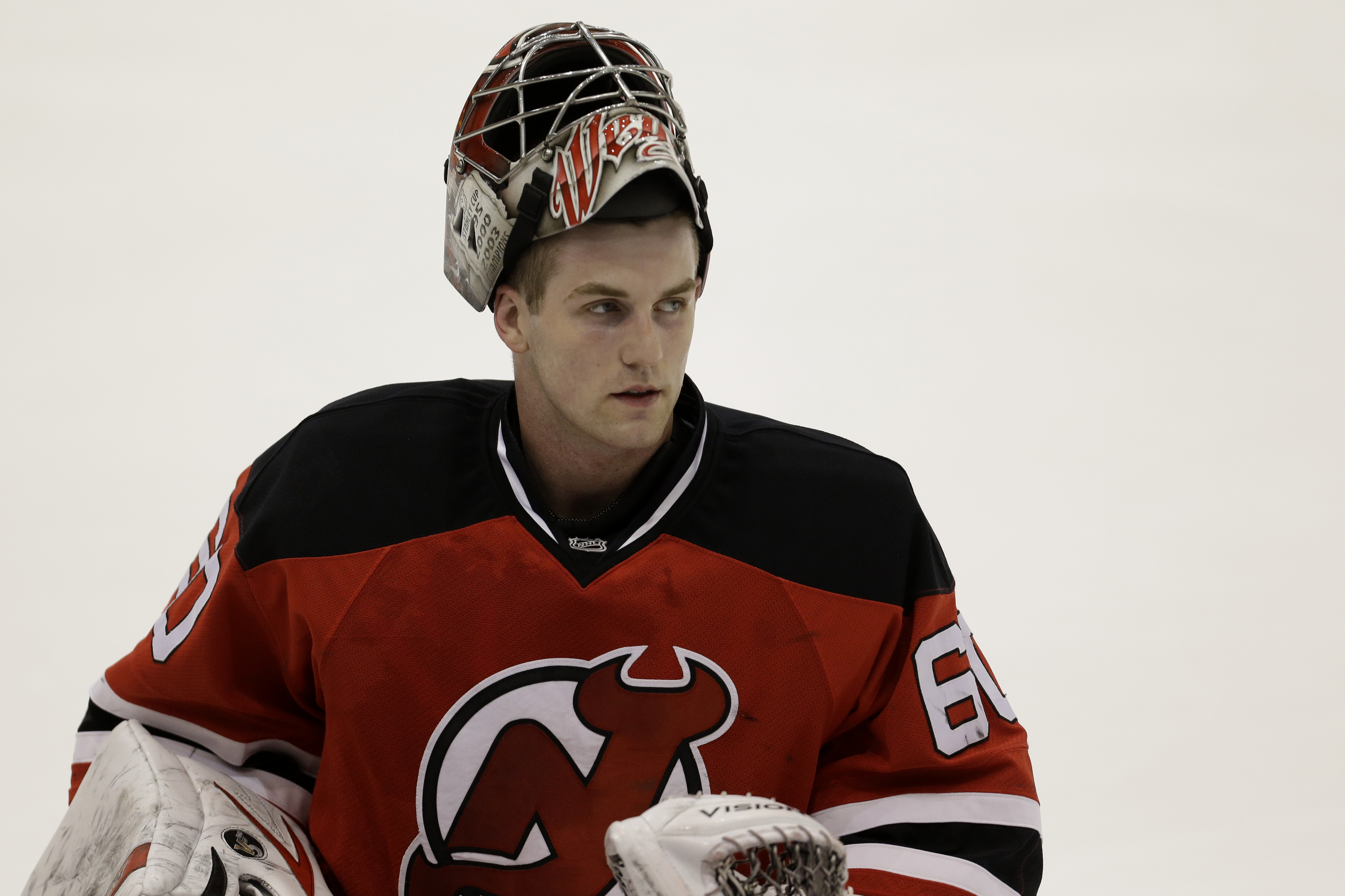 Scott Wedgewood looks on during a break at the New Jersey Devils NHL hockey rookie camp, Wednesday, July 17, 2013, in Newark, N.J. Anthony Brodeur was drafted by the Devils in the seventh round of the NHL draft last month. (AP Photo/Julio Cortez)