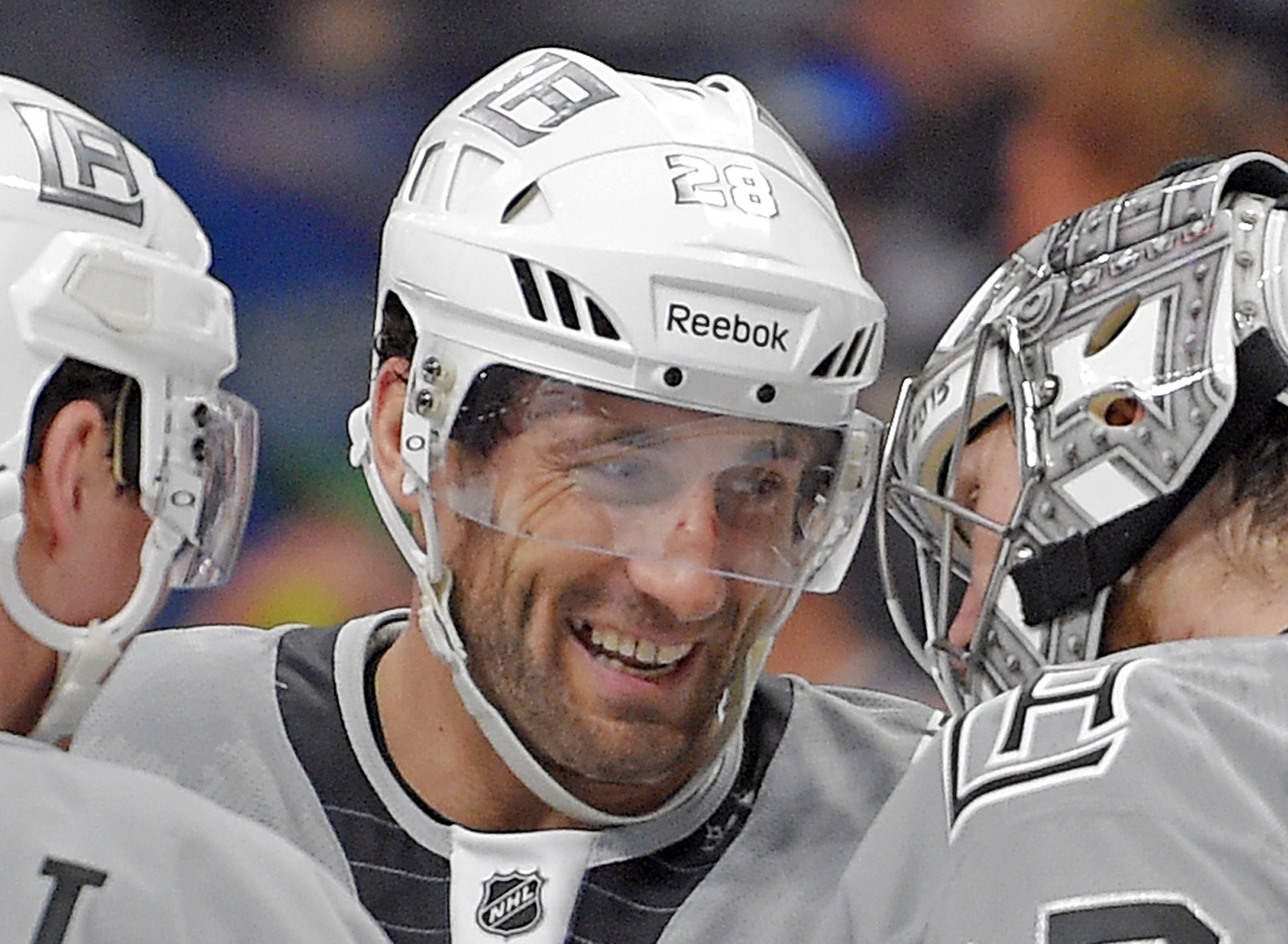 FILE - In this April 11, 2015, file photo, Los Angeles Kings center Jarret Stoll is seen with goalie Jonathan Quick, right, and Tyler Toffoli after an NHL hockey game against the San Jose Sharks in Los Angeles. Stoll has been charged with felony cocaine p