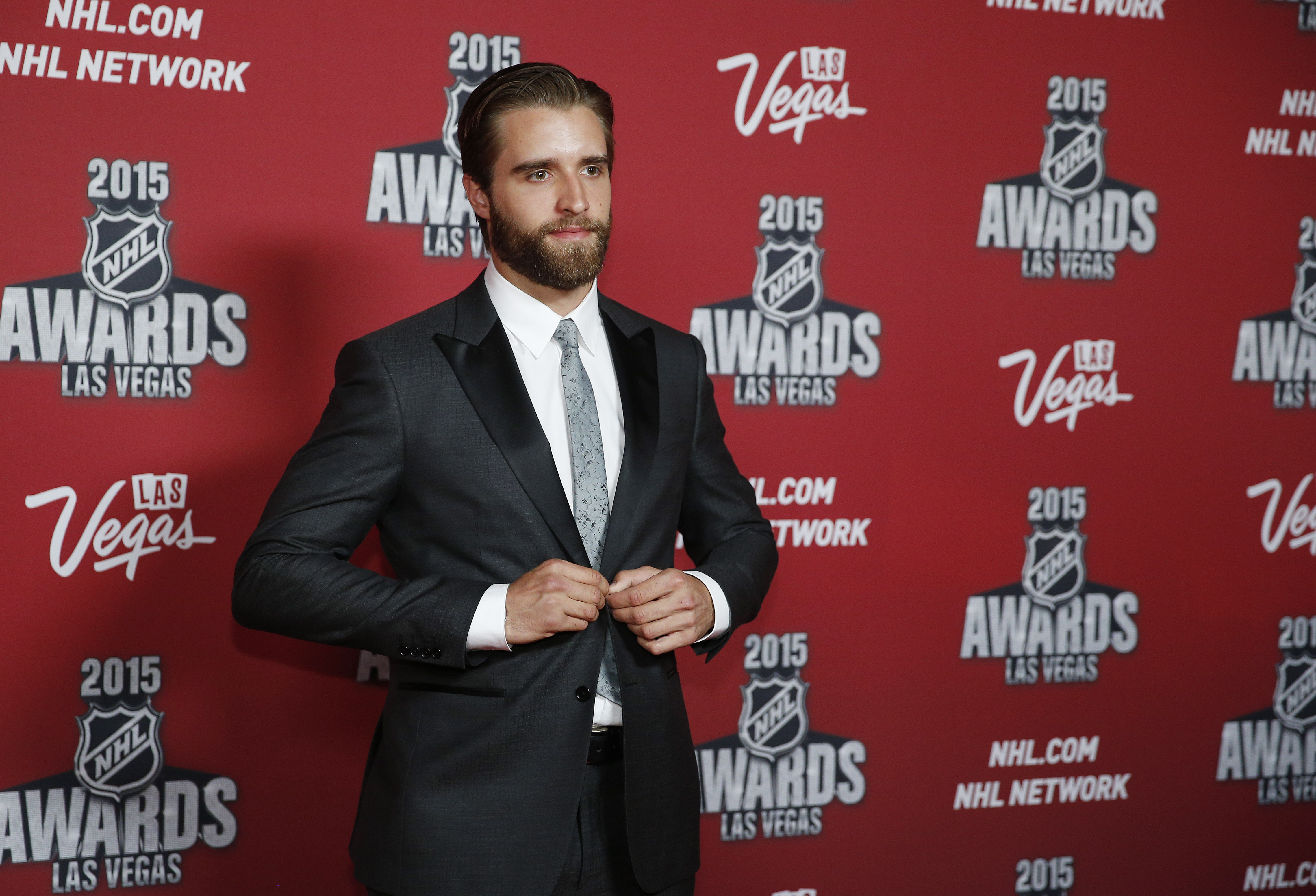 Florida Panthers' Aaron Ekblad poses on the red carpet before the NHL Awards show Wednesday, June 24, 2015, in Las Vegas. (AP Photo/John Locher)