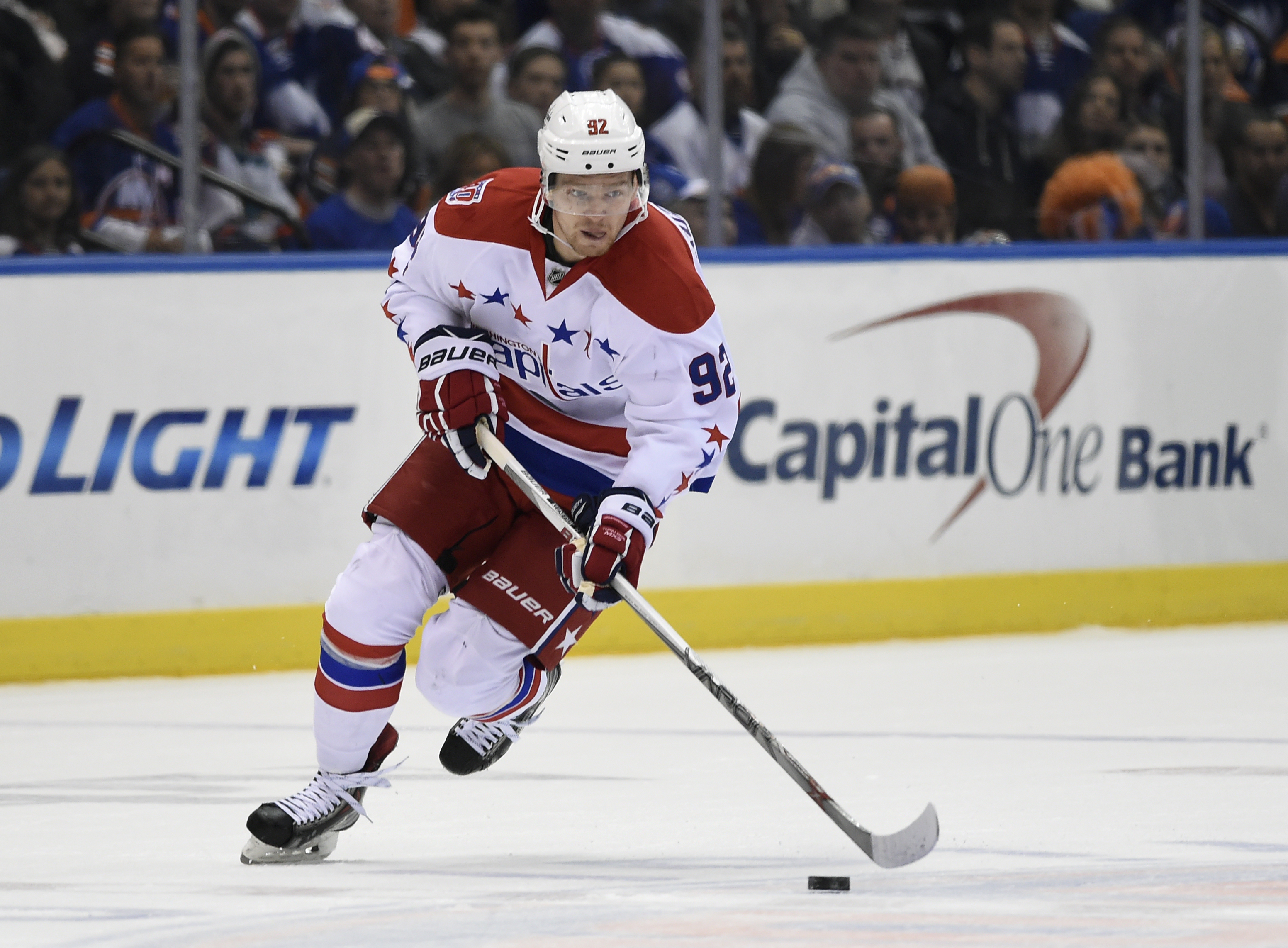 Washington Capitals center Evgeny Kuznetsov (92) drives the puck down ice in the first period of Game 6 of a first-round NHL Stanley Cup hockey playoffs against the New York Islanders at Nassau Coliseum on Saturday, April 25, 2015, in Uniondale, N.Y. (AP