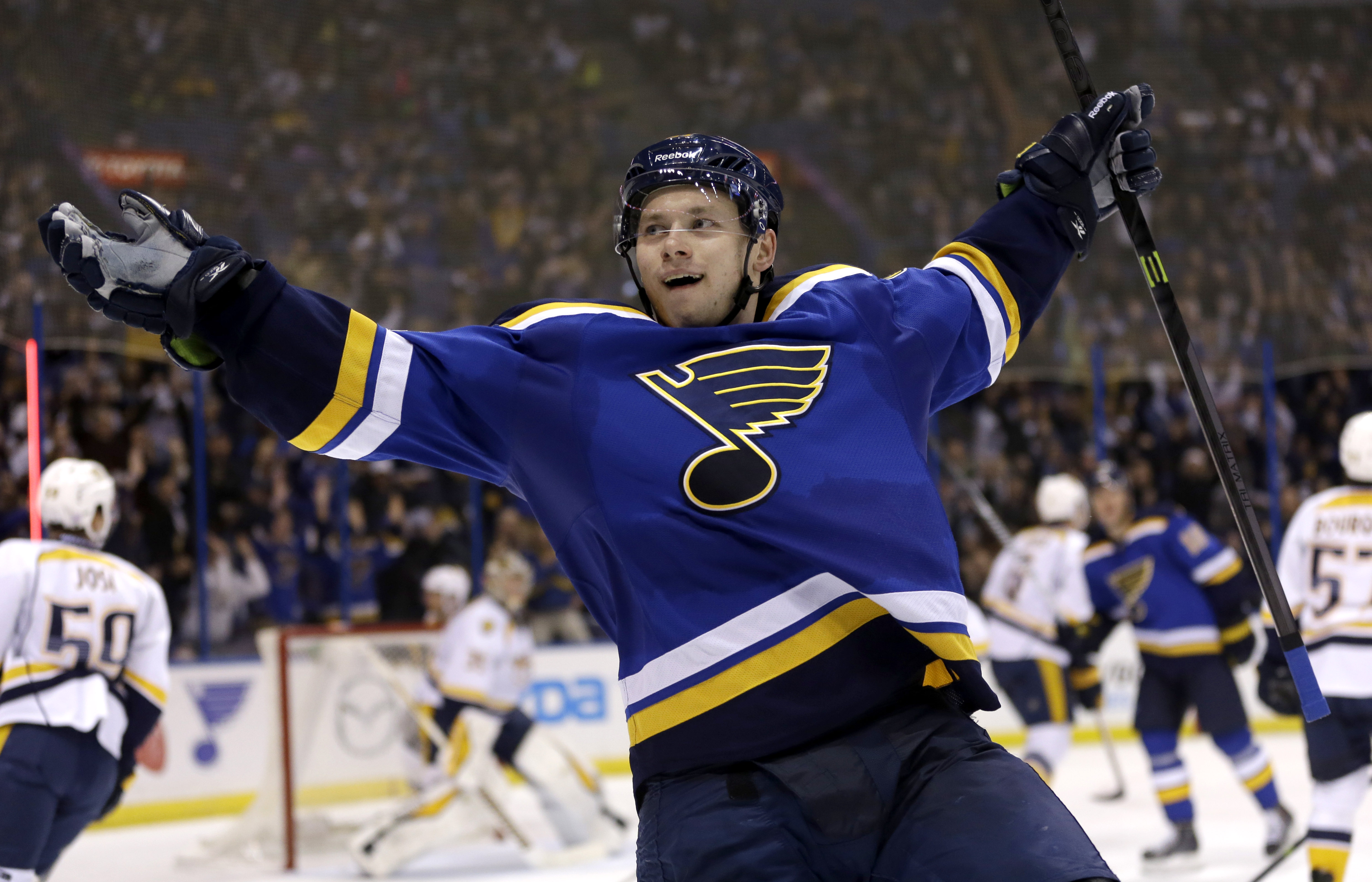 FILE - In this Nov. 13, 2014 file photo, St. Louis Blues' Vladimir Tarasenko, of Russia, celebrates after scoring during the second period of an NHL hockey game against the Nashville Predators in St. Louis. The Blues have signed Tarasenko to a new eight-y