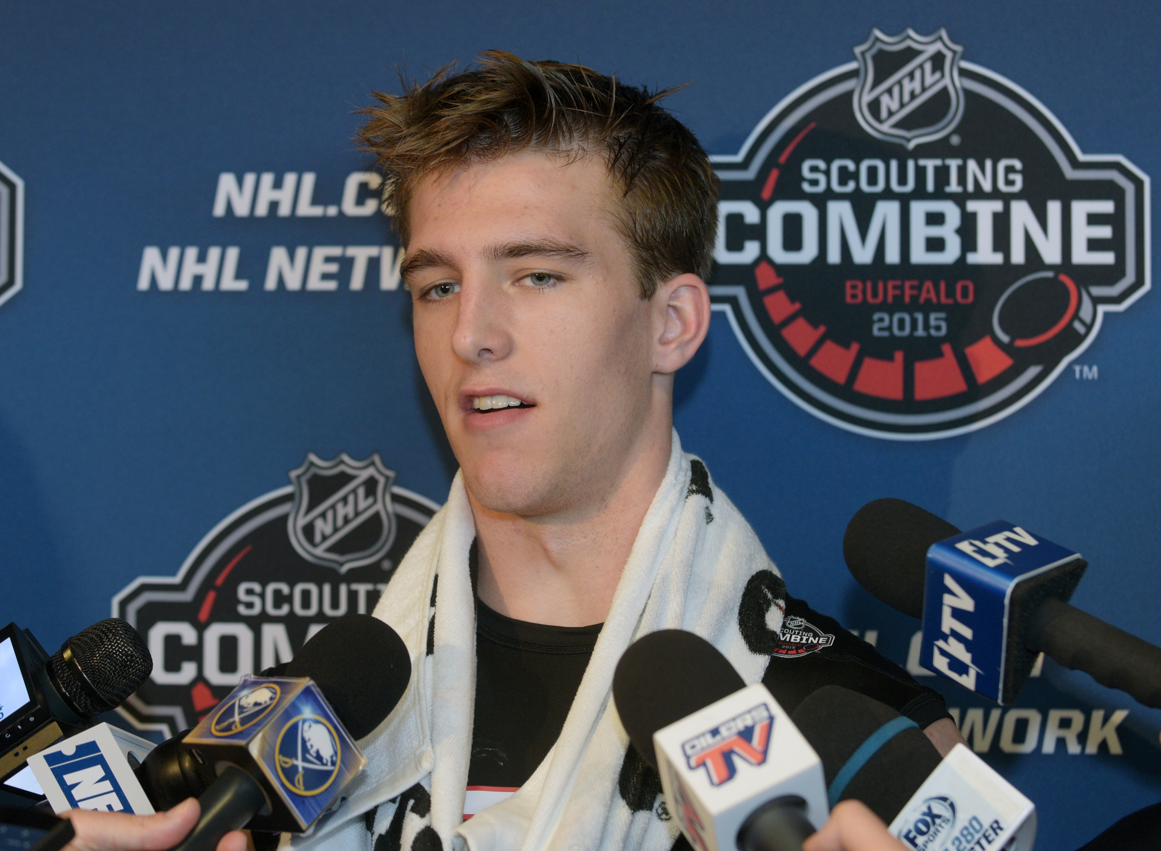Noah Hanifin talks with reporters after he completed his hockey testing at the NHL Combine, Saturday, June 6, 2015, in Buffalo, N.Y. (AP Photo/Gary Wiepert)