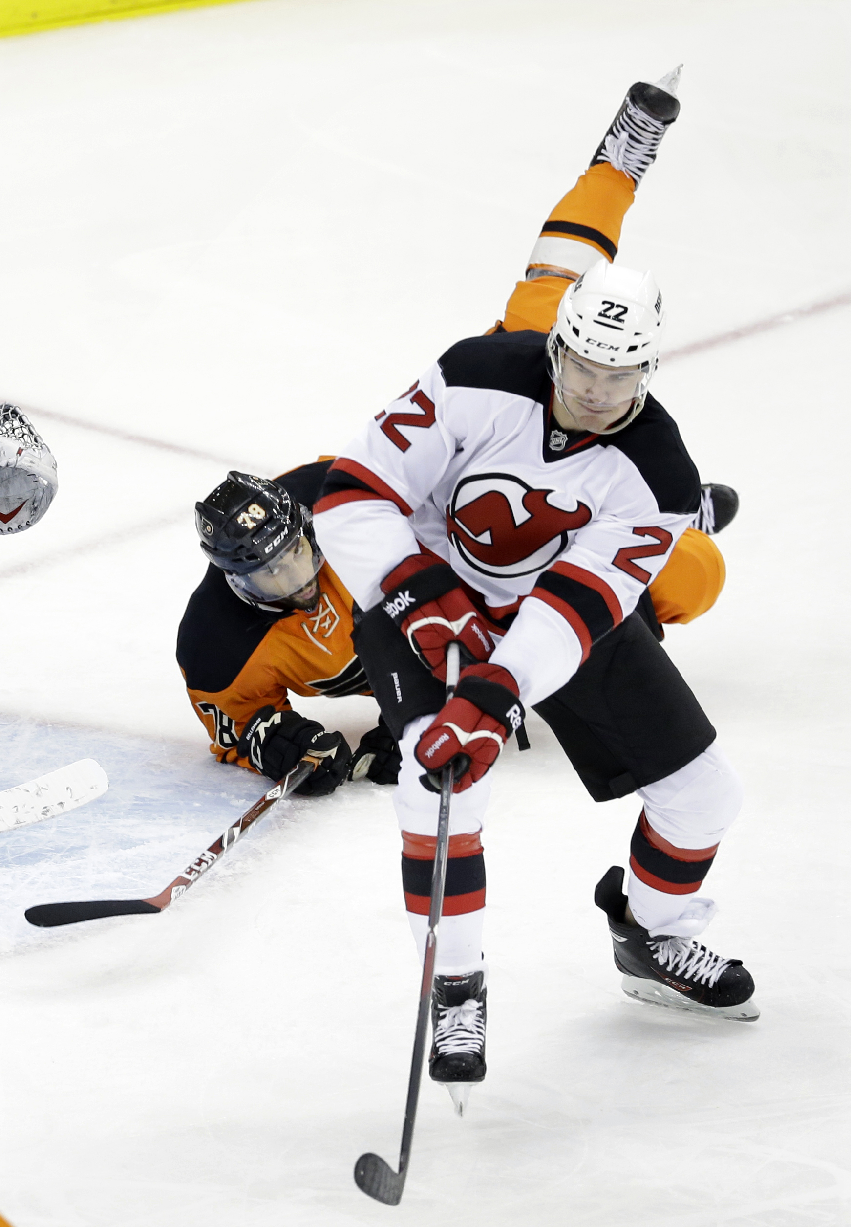 New Jersey Devils' Eric Gelinas (22) skates away after colliding with Philadelphia Flyers' Pierre-Edouard Bellemare (78), of France, during the third period of an NHL hockey game Sunday, March 8, 2015, in Newark, N.J. The Devils won 5-2. (AP Photo/Mel Eva