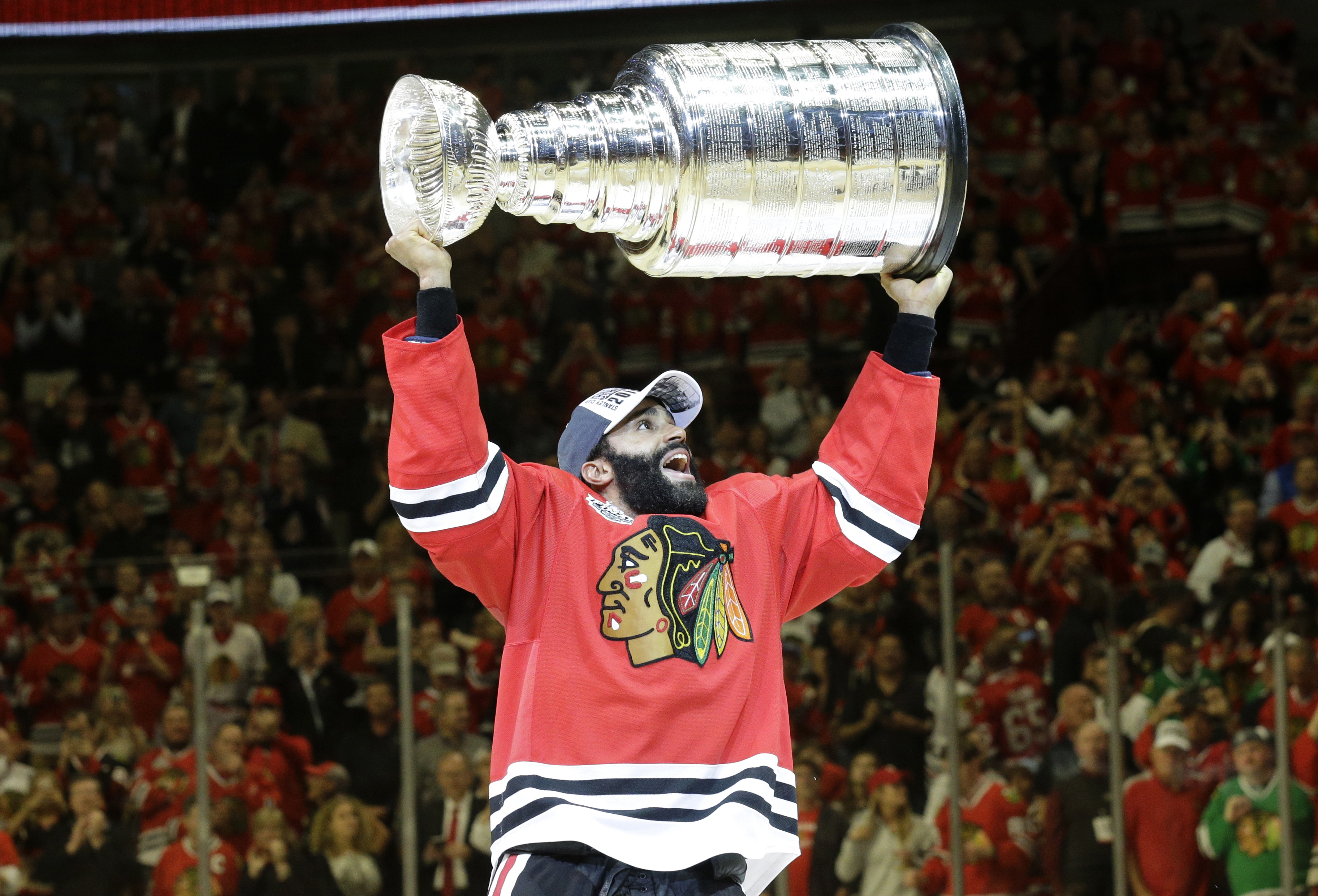 Chicago Blackhawks' Johnny Oduya, of Sweden, celebrates after defeating the Tampa Bay Lightning in Game 6 of the NHL hockey Stanley Cup Final series on Monday, June 15, 2015, in Chicago. The Blackhawks defeated the Lightning 2-0 to win the series 4-2. (