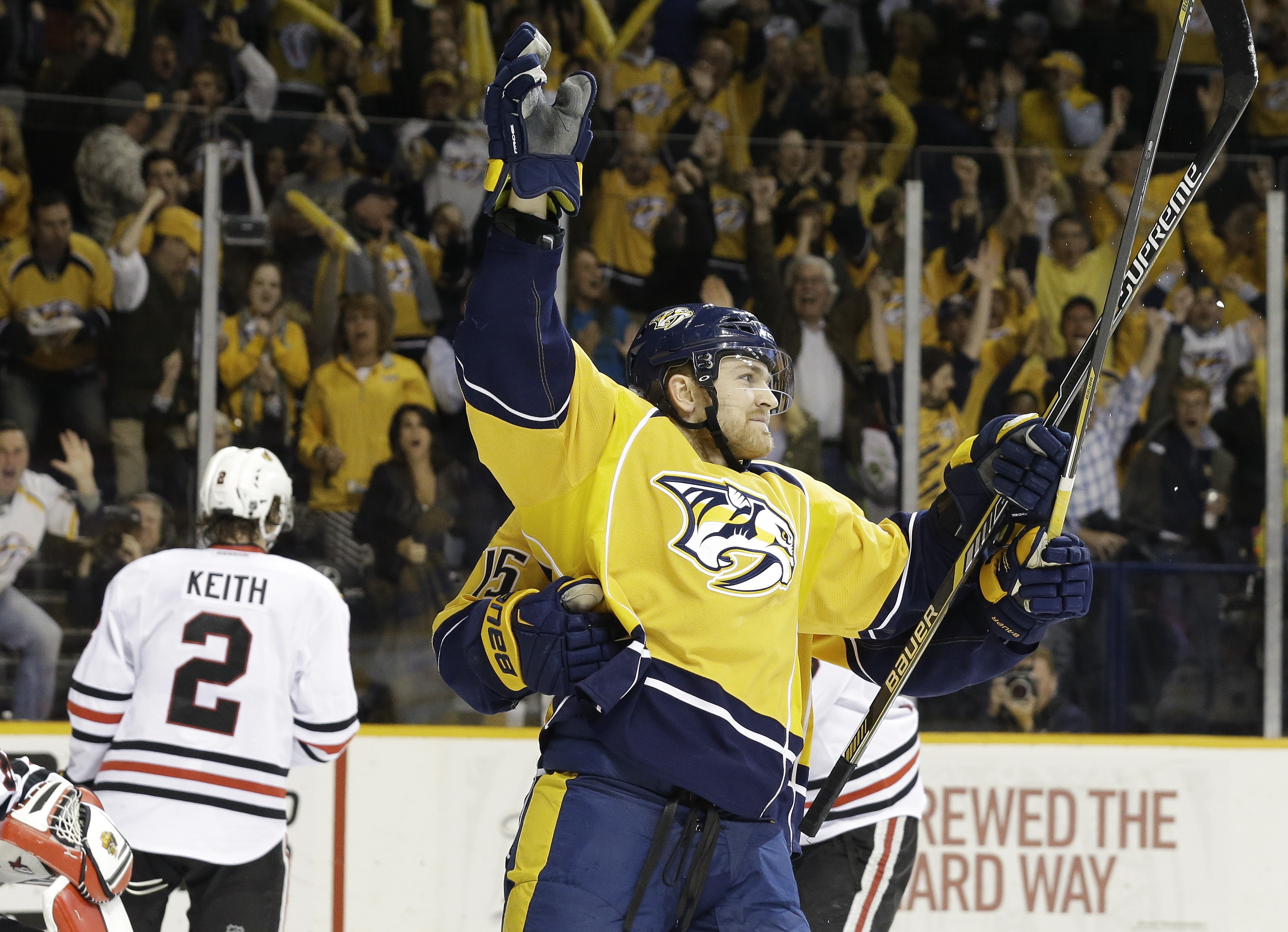 Nashville Predators center Colin Wilson, right, celebrates after scoring a goal against the Chicago Blackhawks during the third period of Game 5 of an NHL hockey first-round playoff series Thursday, April 23, 2015, in Nashville, Tenn. (AP Photo/Mark Humph