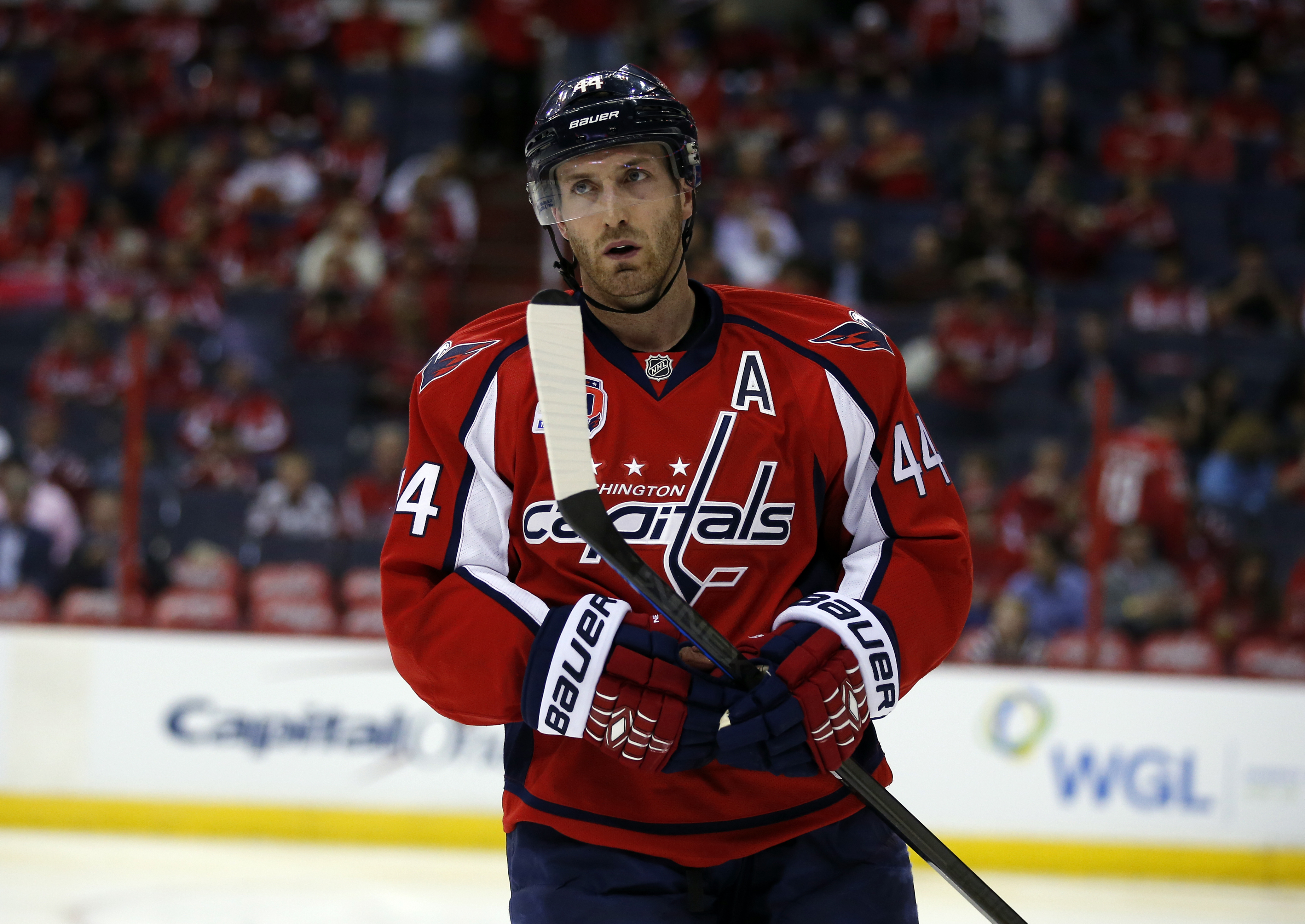 Washington Capitals defenseman Brooks Orpik (44) pauses on the ice before the start of the second period of Game 1 in the first round of the NHL hockey Stanley Cup playoffs against the New York Islanders, Wednesday, April 15, 2015, in Washington. (AP Phot