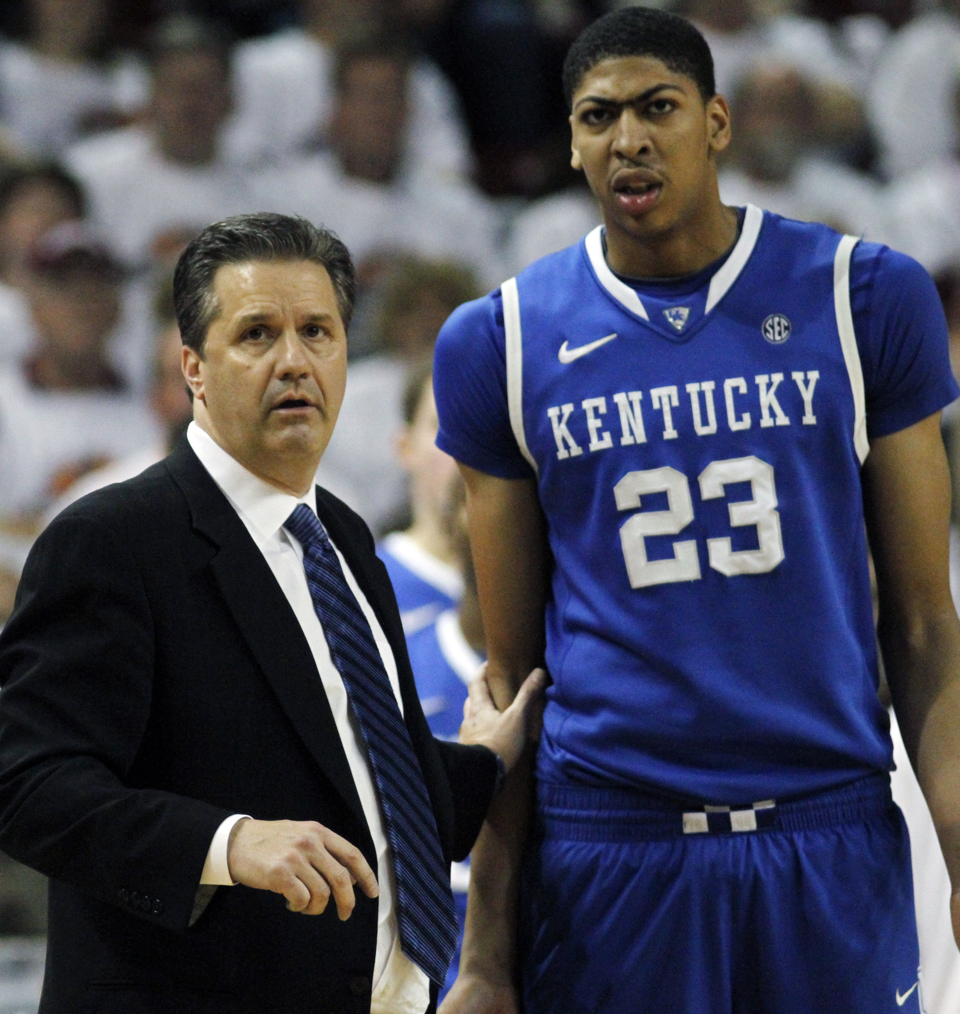 Kentucky basketball coach John Calipari and forward Anthony Davis (23) express concern early in the second half of their NCAA college basketball game against Mississippi State in Starkville, Miss., Tuesday, Feb. 21, 2012. No. 1 Kentucky won 73-64. (AP Pho