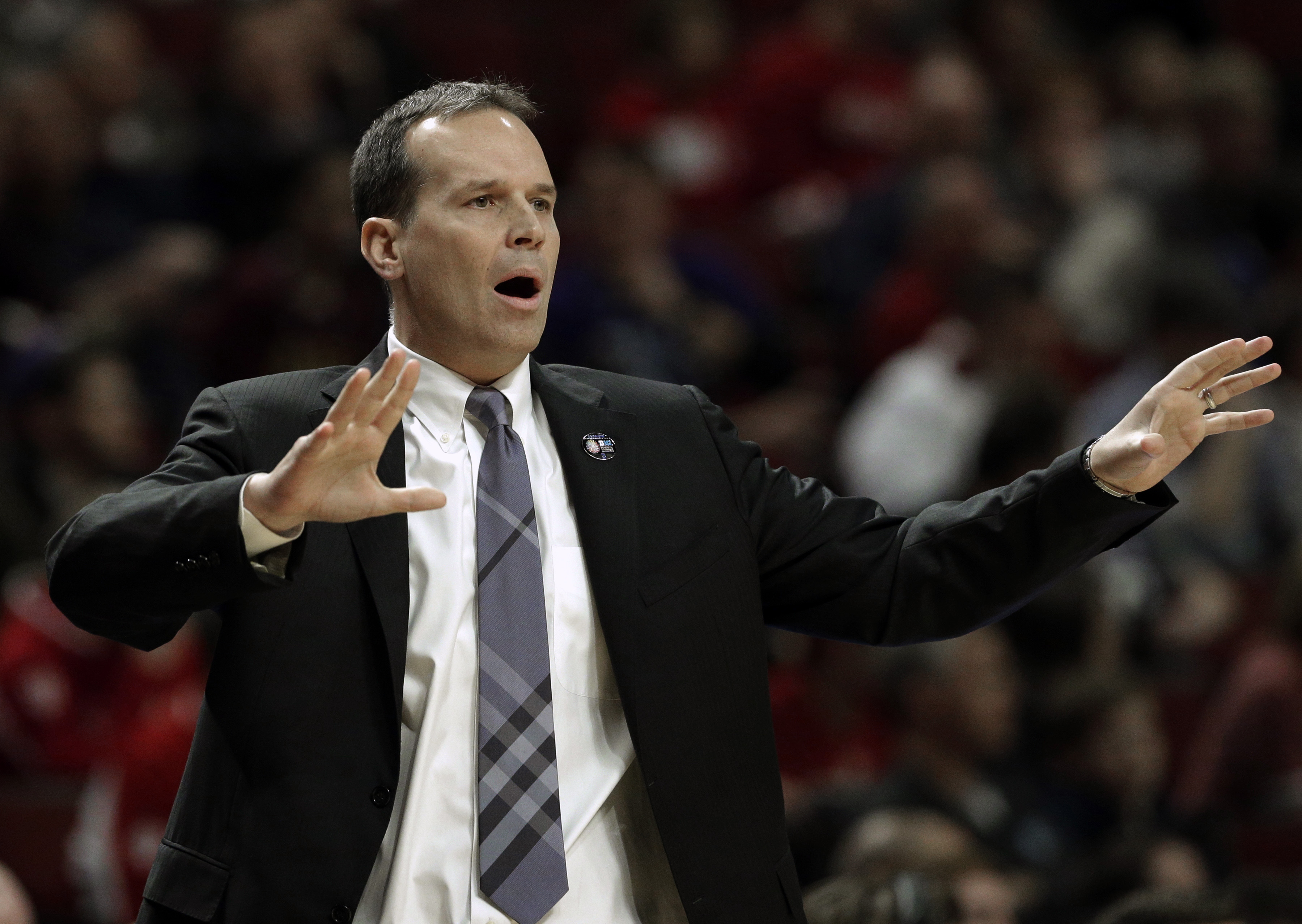 Northwestern head coach Chris Collins directs his team in the first half of an NCAA college basketball game against Indiana in the second round of the Big Ten Conference tournament, Thursday, March 12, 2015, in Chicago. (AP Photo/Nam Y. Huh)