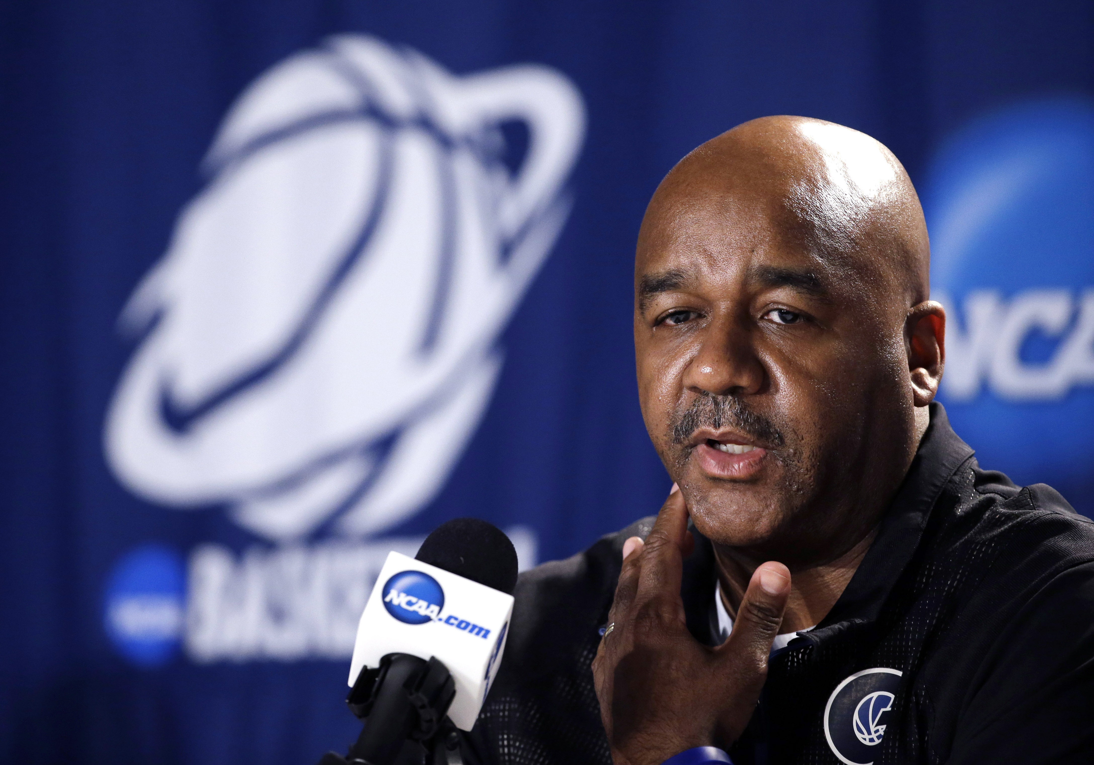 FILE - In this March 20, 2015, file phot, Georgetown coach John Thompson III speaks during a news conference at the NCAA college basketball tournament in Portland, Ore. The National Association For Coaching Equity and Development, a group led by Texas Tec