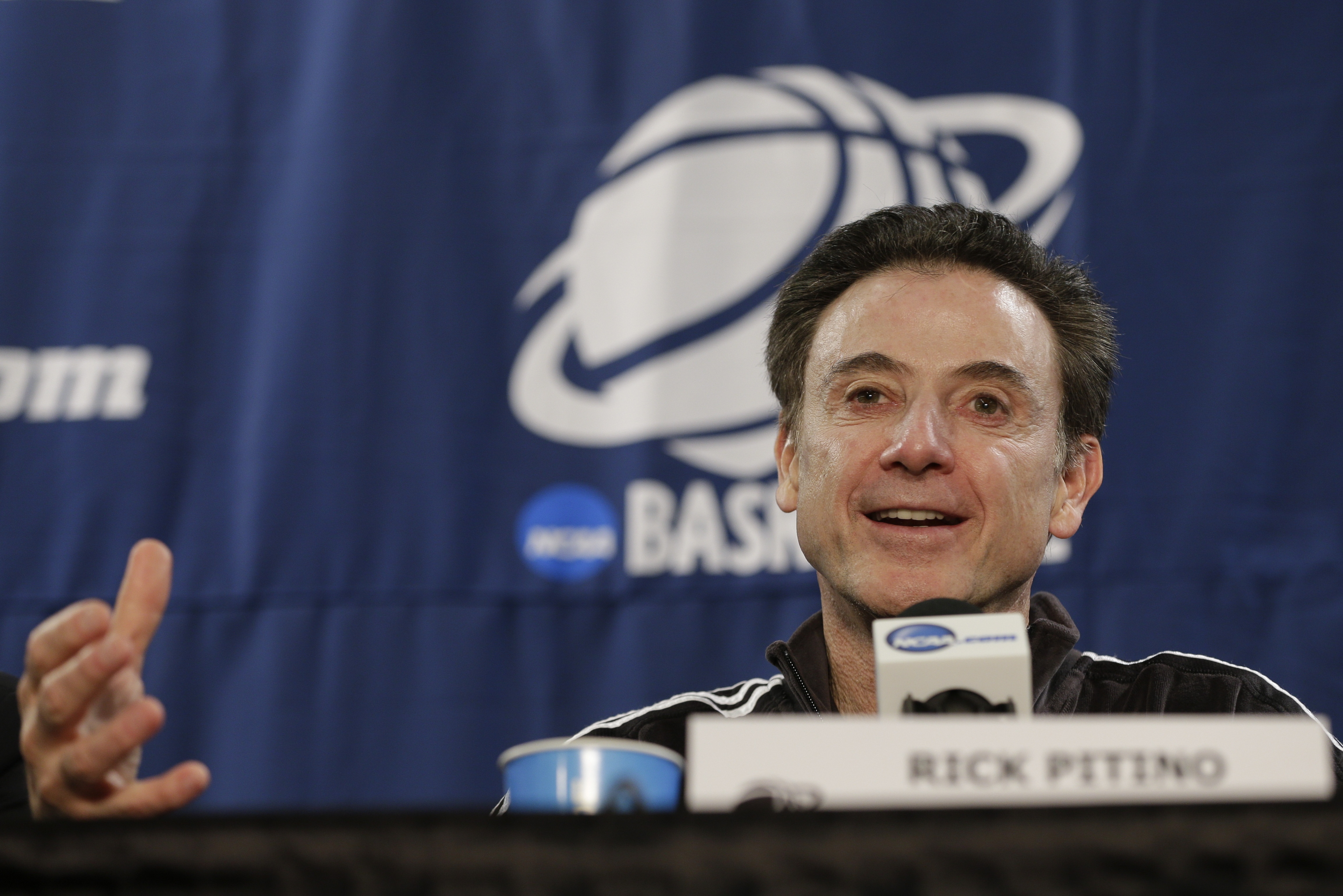 Louisville head coach Rick Pitino speaks during a news conference at the NCAA college basketball tournament Saturday, March 28, 2015, in Syracuse, N.Y. Louisville plays Michigan State in a regional final on Sunday. (AP Photo/Frank Franklin II)