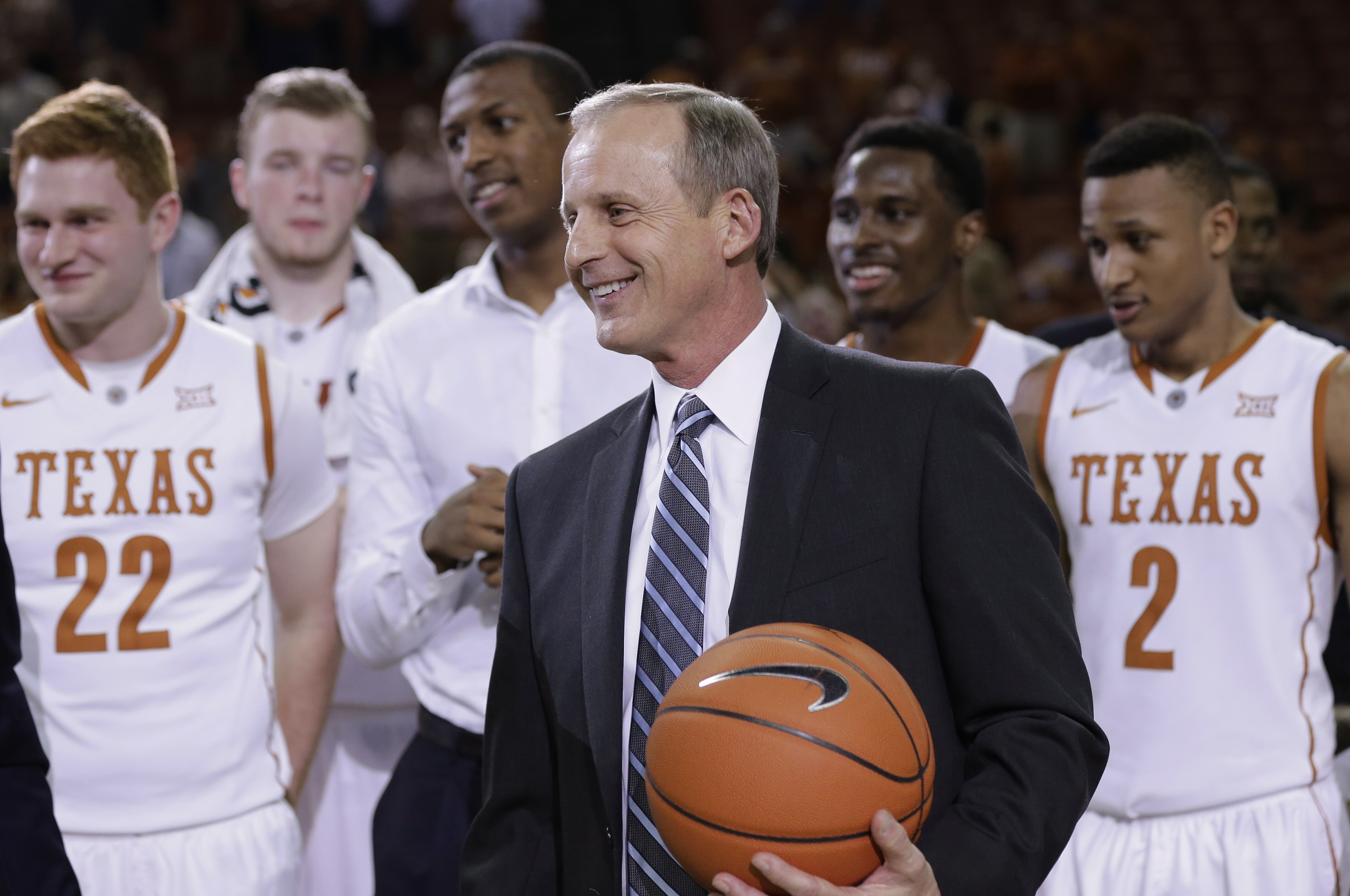 Texas coach Rick Barnes is given a game ball following his team's NCAA college basketball game against TCU, Wednesday, Feb. 11, 2015, in Austin, Texas. Texas won 66-43, giving Barnes his 600th win. (AP Photo/Eric Gay)