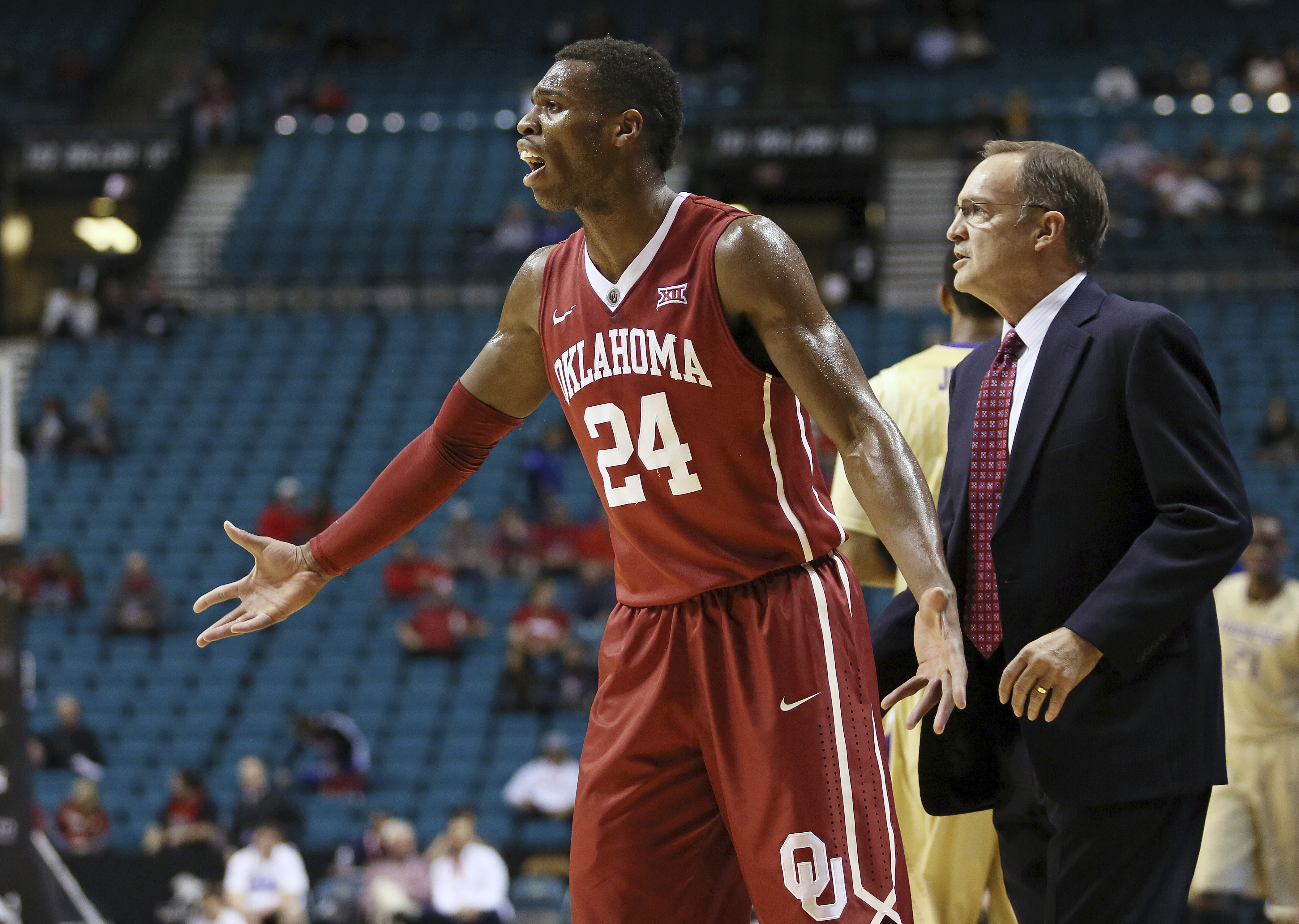 FILE - In this Dec. 20, 2014, file photo, Oklahoma's Buddy Hield reacts to a call during the first half of a NCAA college basketball game against Washington in Las Vegas. Oklahoma coach Lon Kruger is at right. Kruger appears poised for the best run of his