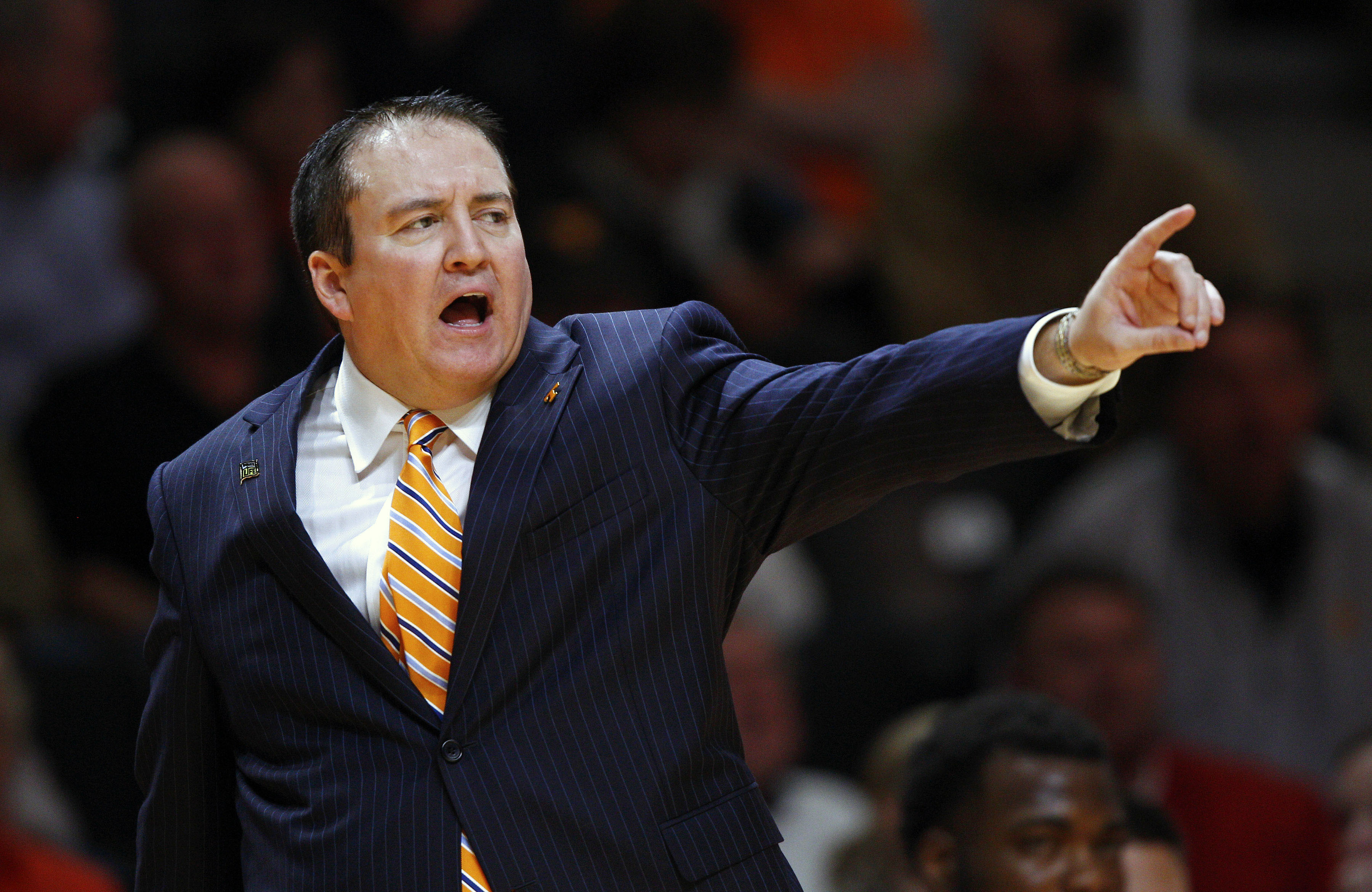 FILE - In this Monday, Nov. 3, 2014 file photo, Tennessee head coach Donnie Tyndall in the second half of an NCAA college basketball game against Pikeville in Knoxville, Tenn. The NCAA says Southern Mississippi's men's basketball program and former coach