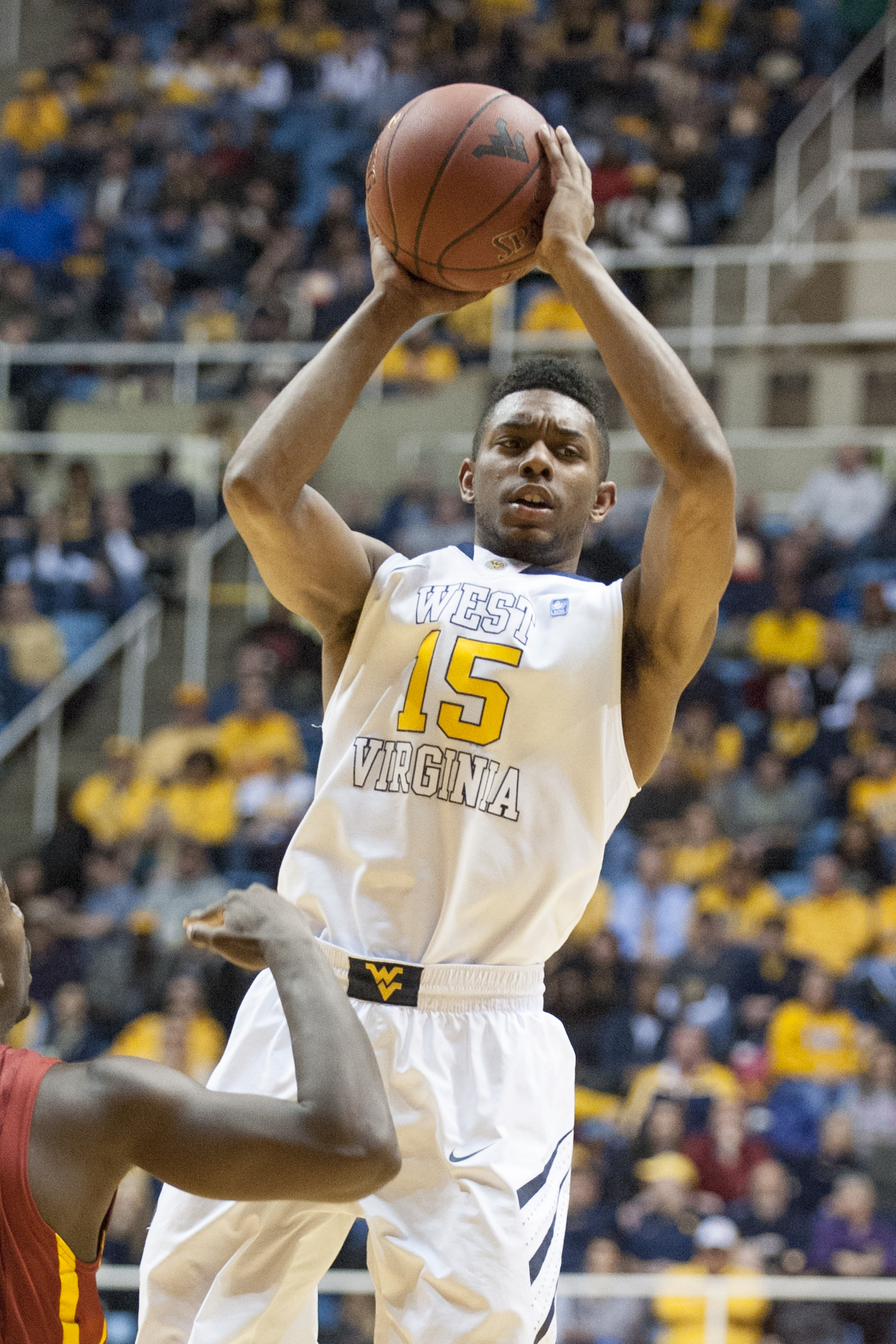 FILE - In this Monday, Feb. 10, 2014, file photo, West Virginia's Terry Henderson (15) looks to pass during an NCAA college basketball game against Iowa State, in Morgantown, W.Va. After two seasons at West Virginia the 6-foot-4 guard sat out last year as