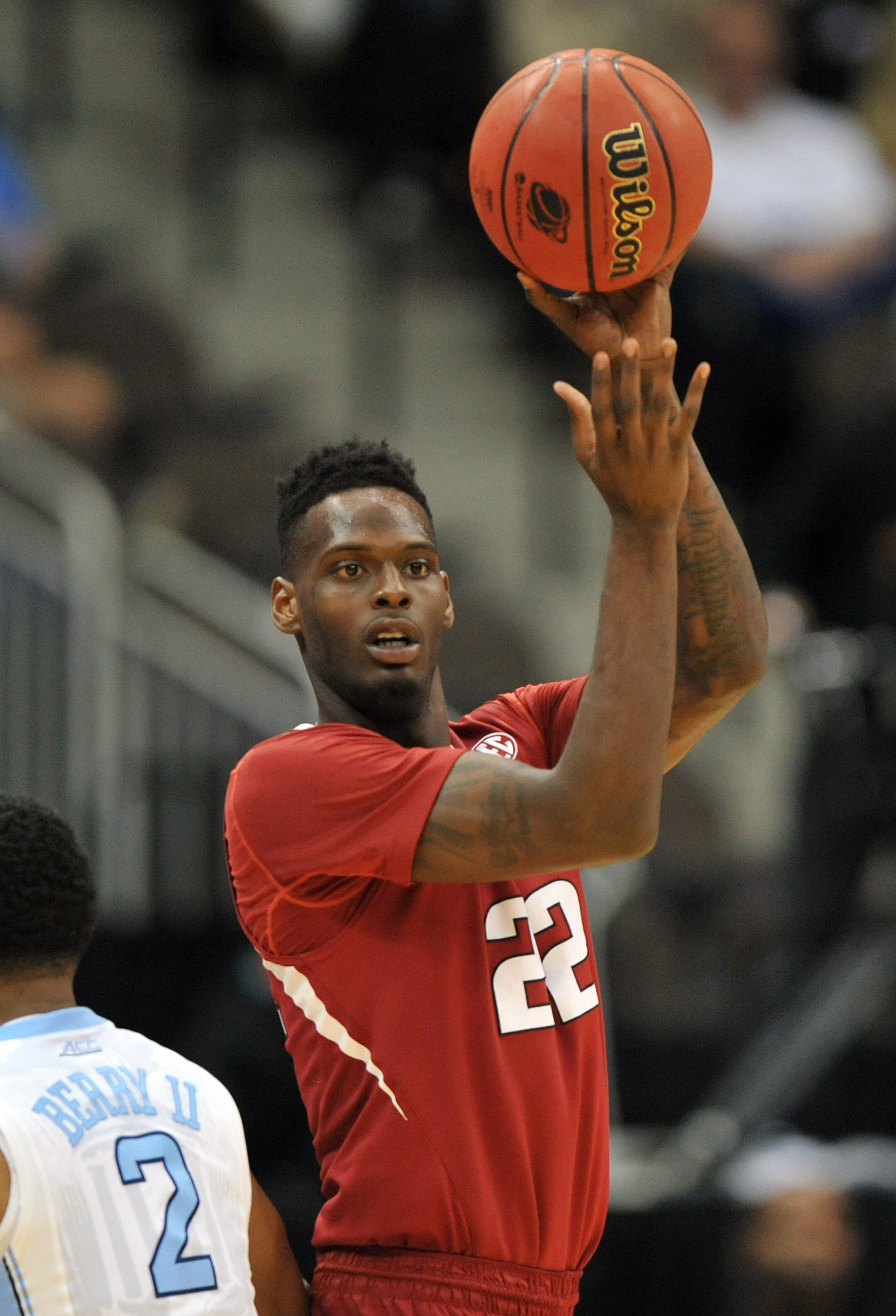 Arkansas forward Jacorey Williams (22) grabs a rebound during the second half of an NCAA tournament third round basketball game against North Carolina Saturday, March 21, 2015, in Jacksonville, Fla.  (AP Photo/Rick Wilson)