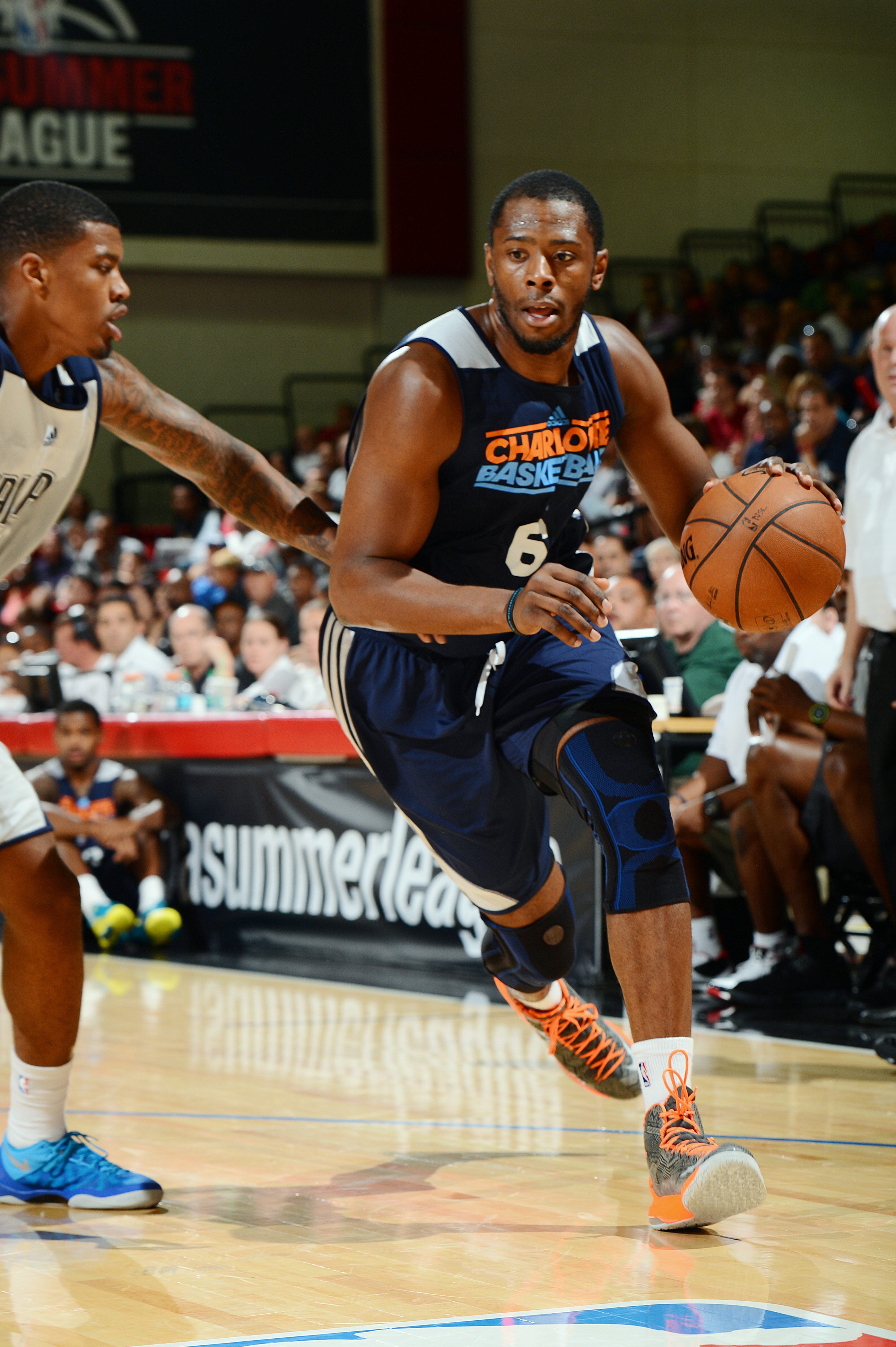 LAS VEGAS, NV - JULY 14: Patrick Ewing Jr. #6 of the Charlotte Bobcats drives against the Dallas Mavericks during NBA Summer League on July 14, 2013 at the Cox Pavilion in Las Vegas, Nevada. (Photo by Garrett W. Ellwood/NBAE via Getty Images)