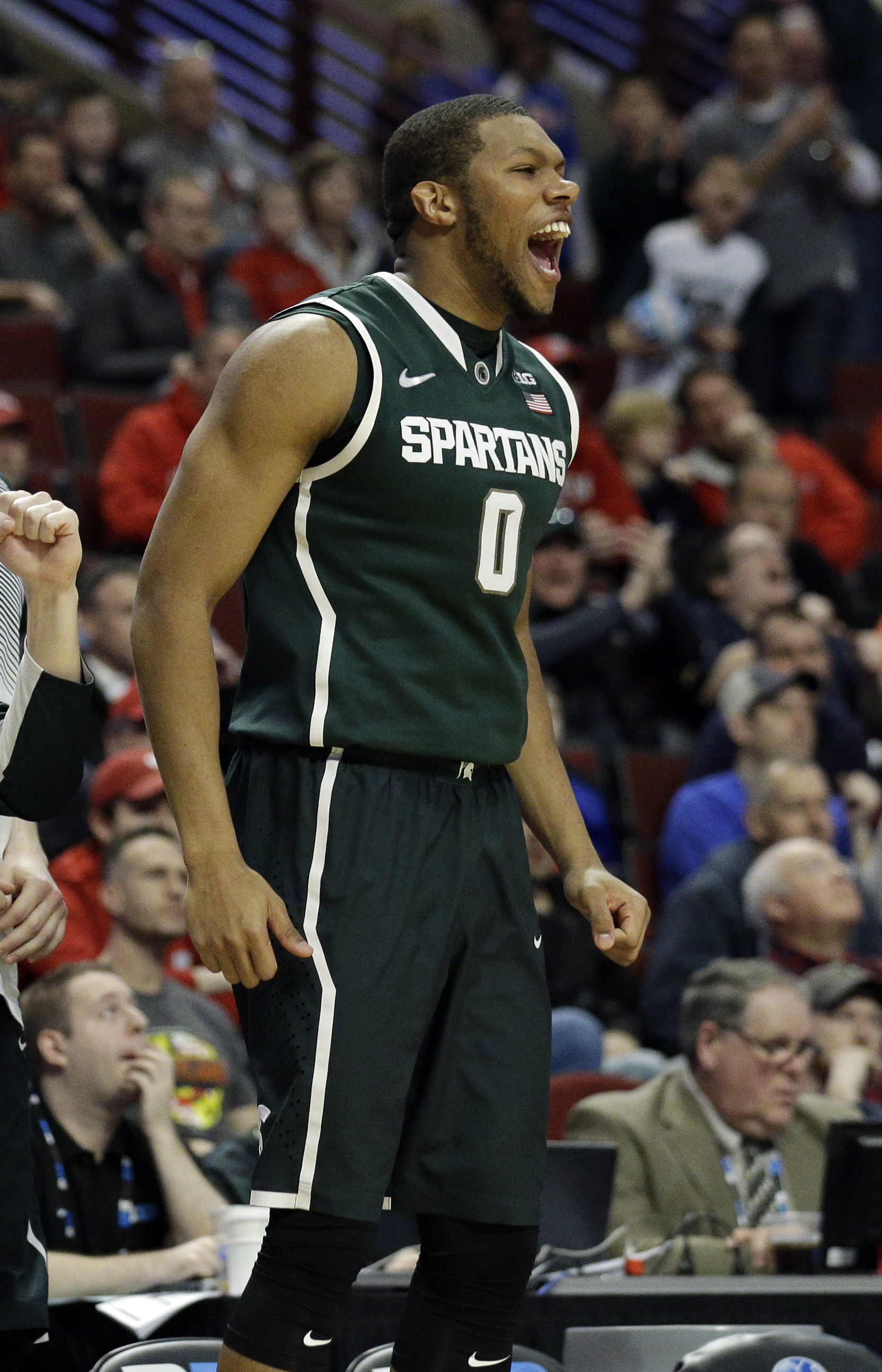 Michigan State's Marvin Clark Jr. (0) celebrate on the bench in the second half of an NCAA college basketball game against Maryland in the semifinals of the Big Ten Conference tournament in Chicago, Saturday, March 14, 2015. Michigan State defeated Maryla