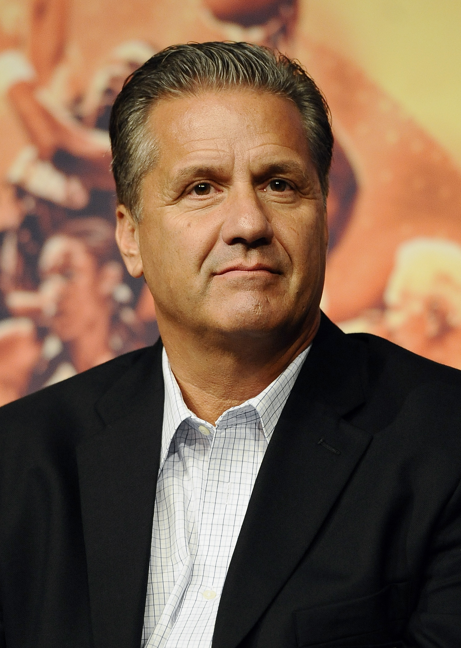 John Calipari of the 2015 class of inductee into the Basketball Hall of Fame during a news conference at the Naismith Memorial Basketball Hall of Fame, Thursday, Sept. 10, 2015, in Springfield, Mass. (AP Photo/Jessica Hill)