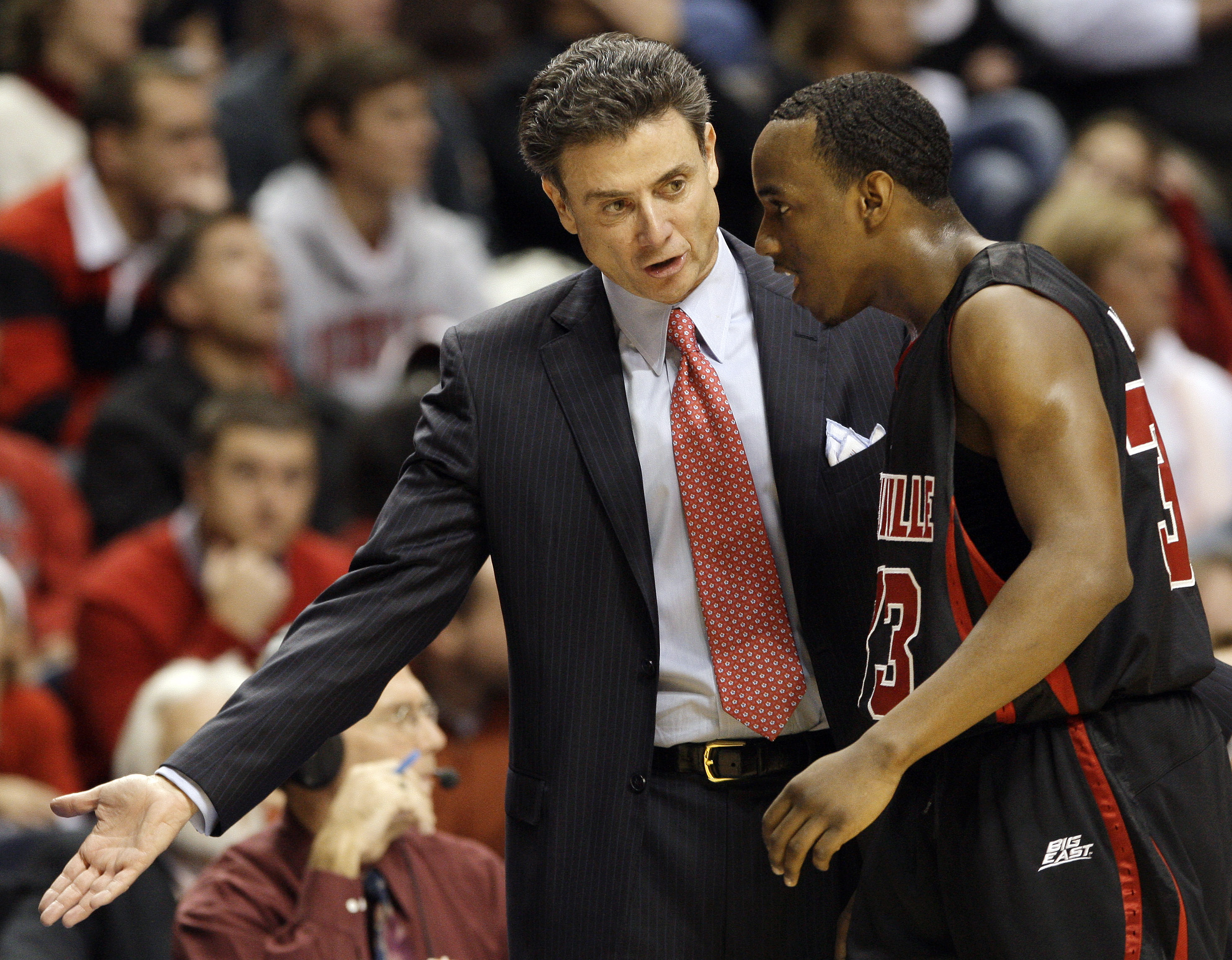 Louisville head coach Rick Pitino talks with guard Andre McGee, right, in the first half of an NCAA college basketball game against Western Kentucky in Nashville, Tenn., Sunday, Nov. 30, 2008. Western Kentucky upset Louisville 68-54. (AP Photo/Mark  Humph