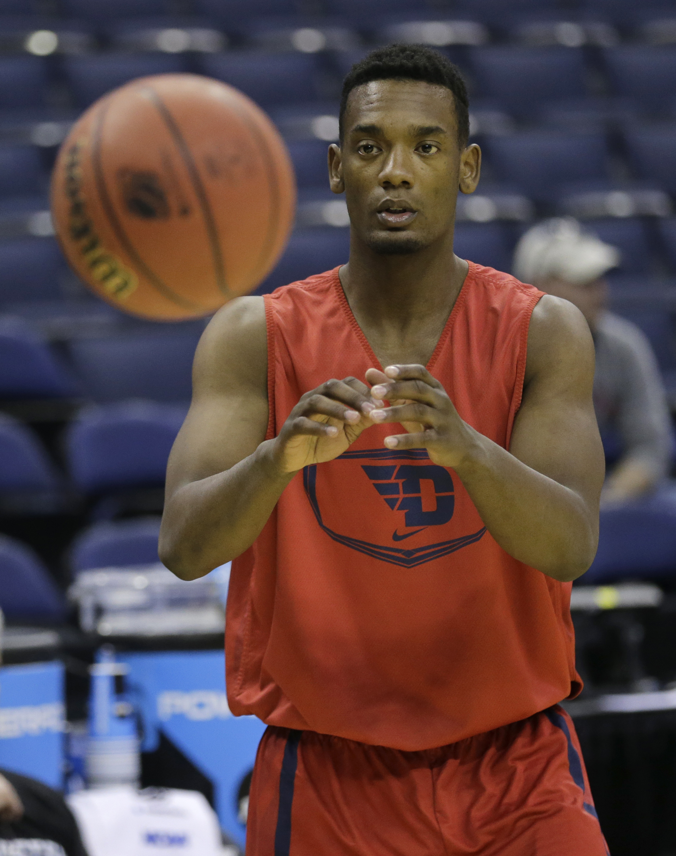 FILE - This Thursday, March 19, 2015, file photo shows Dayton's Dyshawn Pierre catching a pass during practice for an NCAA college basketball tournament second-round game in Columbus, Ohio. Pierre has sued the Ohio school in federal court over his suspens