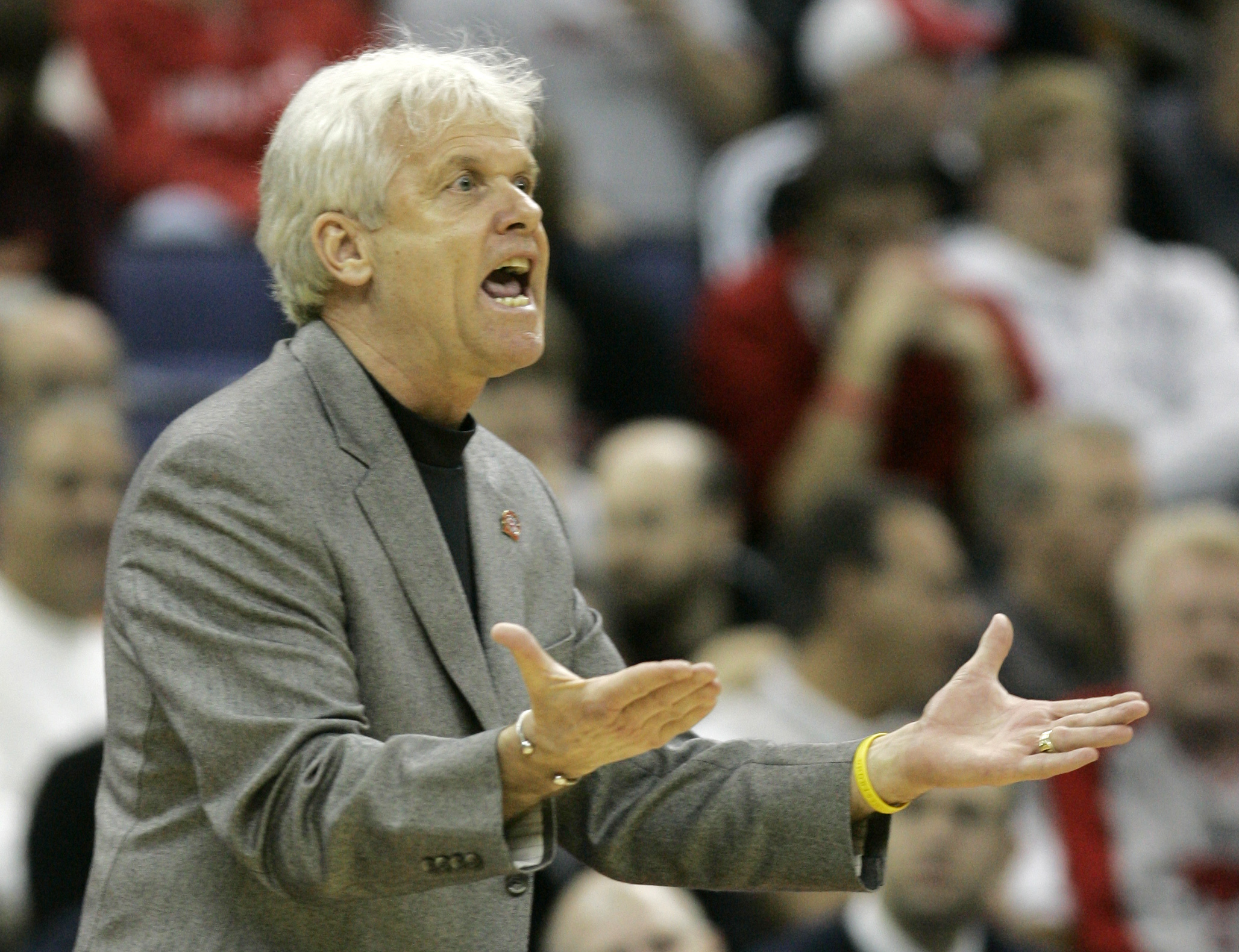 Holy Cross coach Ralph Willard protests a call Friday, March 16, 2007, during an NCAA first-round basketball game against Southern Illinois in Columbus, Ohio. (AP Photo/Tony Dejak)