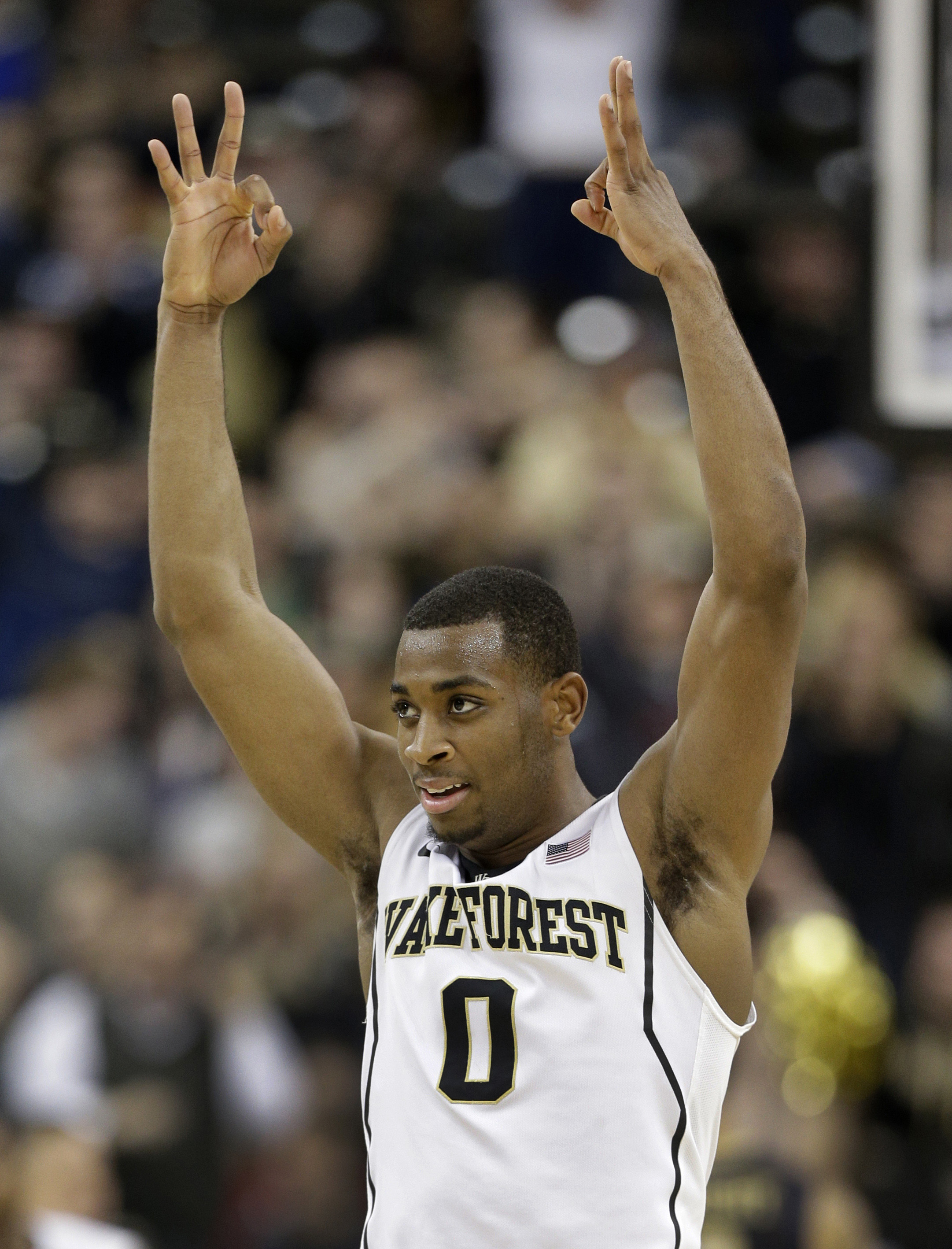Wake Forest's Codi Miller-McIntyre (0) reacts after a teammate's 3-point basket against Pittsburgh during the second half of an NCAA college basketball game in Winston-Salem, N.C., Sunday, March 1, 2015. Wake Forest won 69-66. (AP Photo/Chuck Burton)