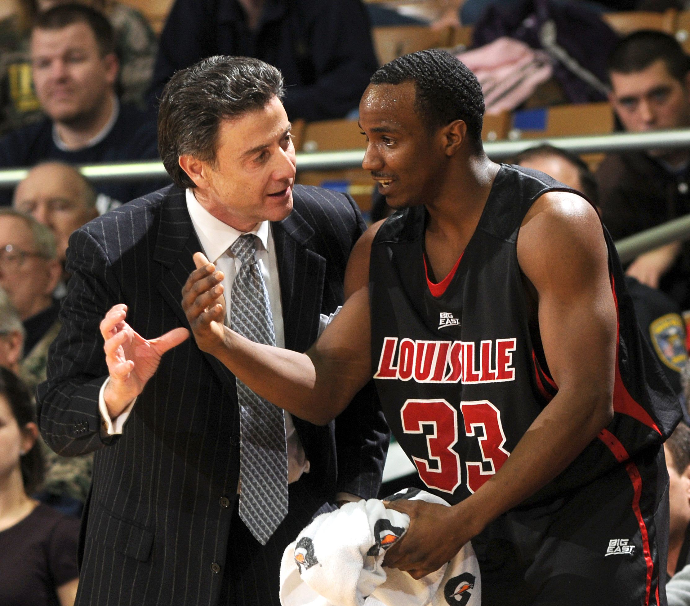 FILE - In this Feb. 12, 2009, file photo Louisville coach Rick Pitino, left, talks with guard Andre McGee during the first half of an NCAA college men's basketball game against Notre Dame in South Bend, Ind. Escort Katina Powell says she has no proof that