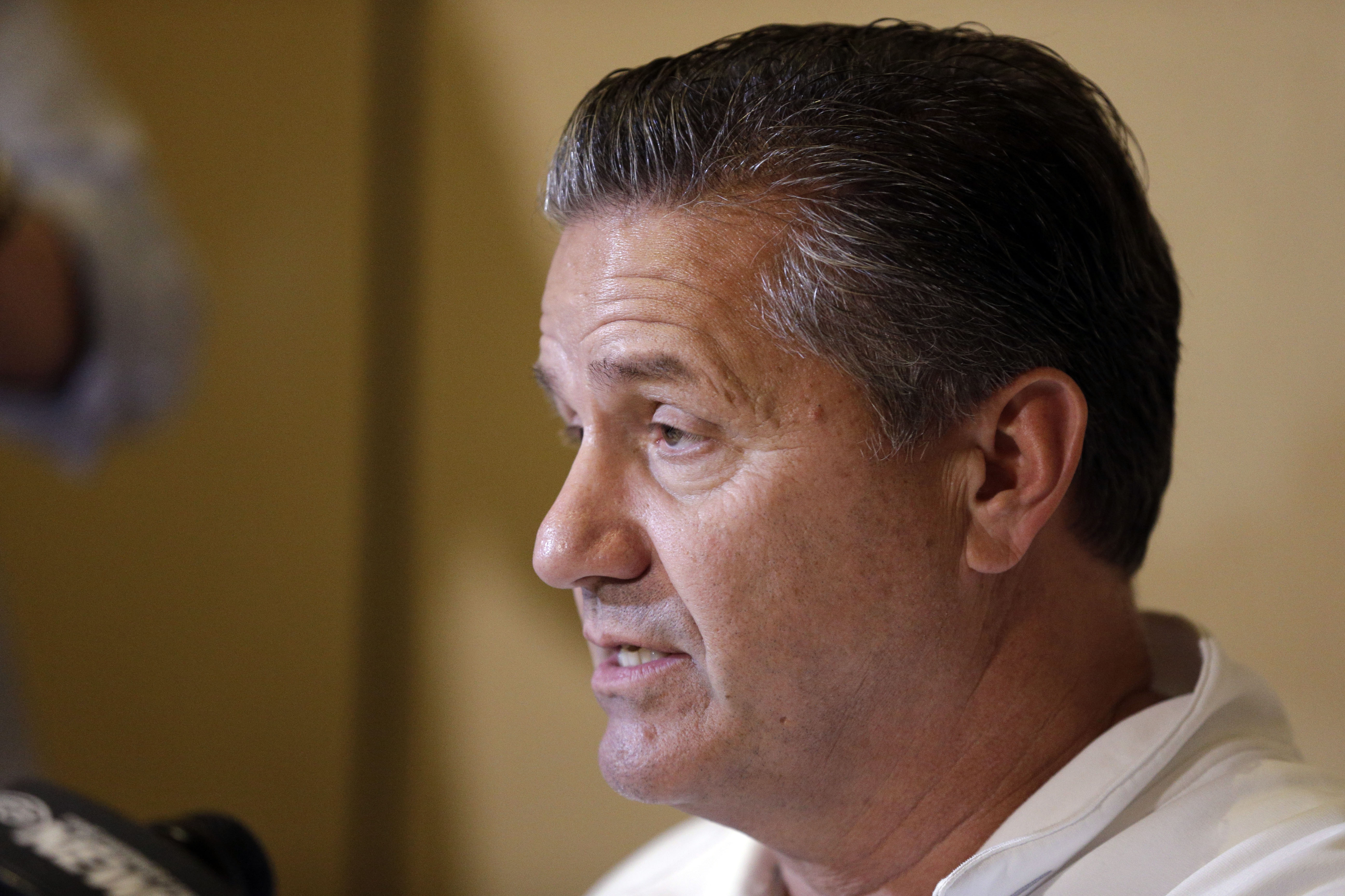 Kentucky head coach John Calipari answers a question during the Southeastern Conference men's NCAA college basketball media day in Charlotte, N.C., Wednesday, Oct. 21, 2015. (AP Photo/Chuck Burton)