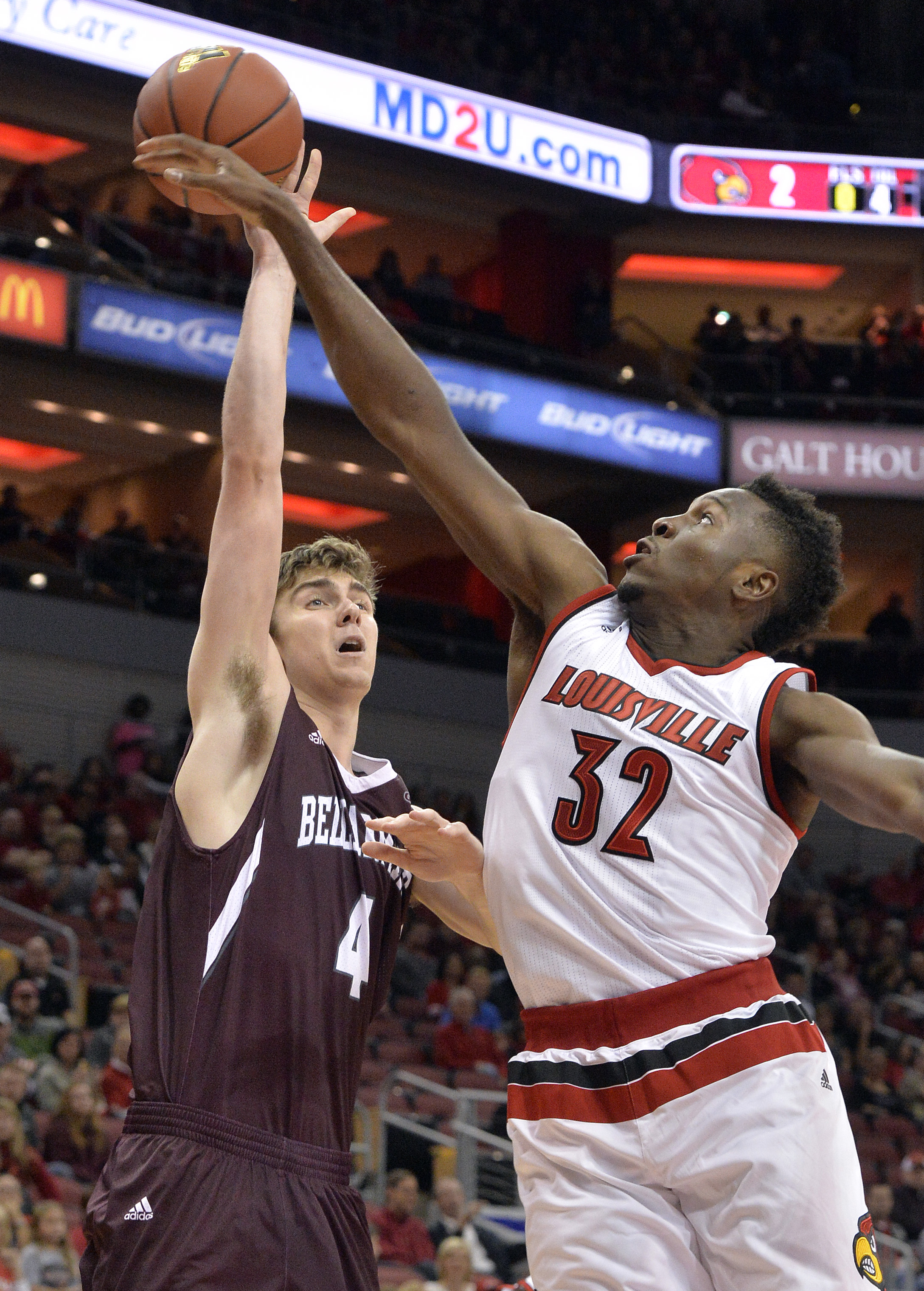 Louisville's Chinanu Onuaku (32) blocks the shot of Bellamine's George Suggs (4) during an NCAA college basketball exhibition game, Sunday, Nov. 1, 2015, in Louisville, Ky. (AP Photo/Timothy D. Easley)