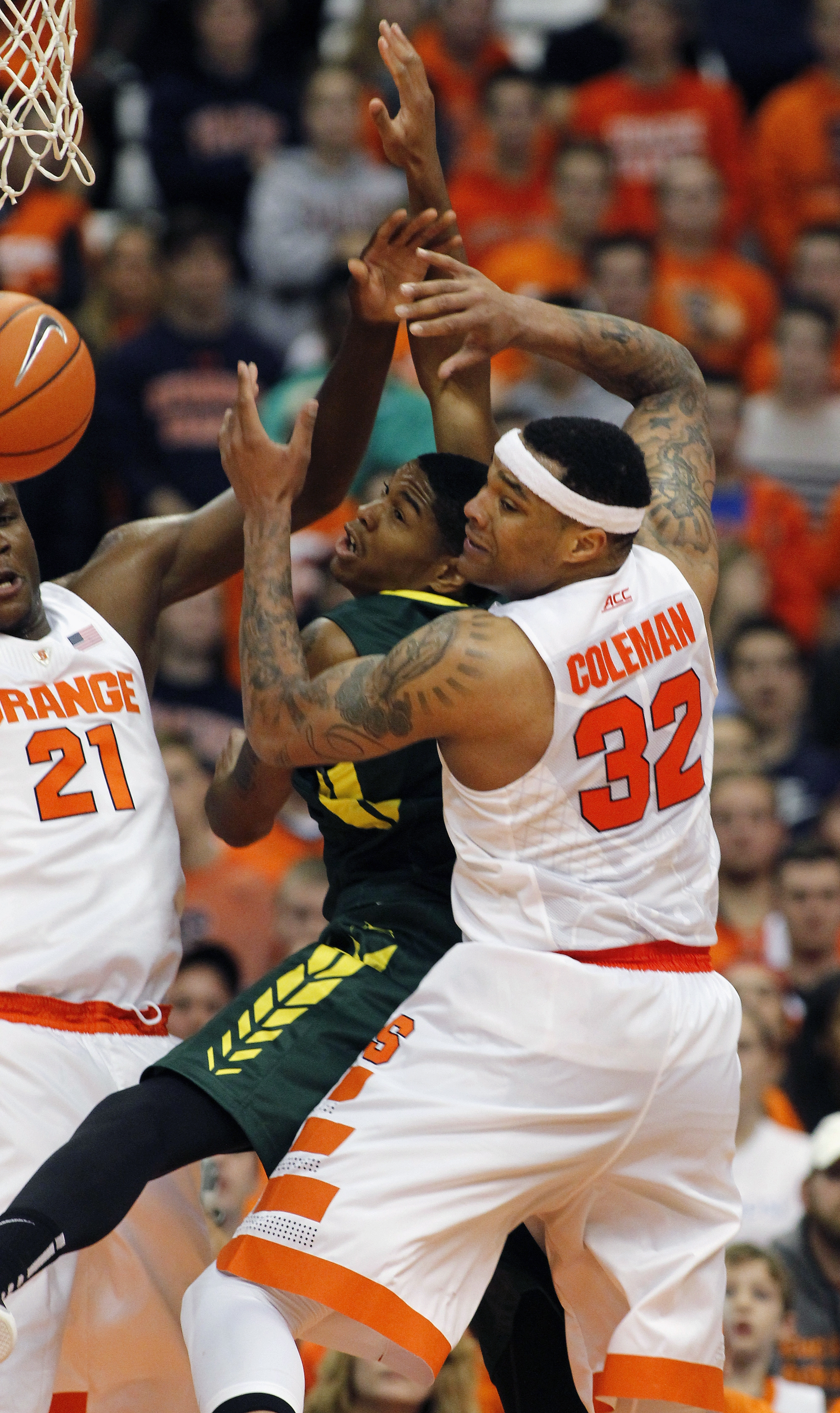 Syracuse's Tyler Roberson, left, and Dajuan Coleman, right, put pressure on Le Moyne's Daniel Kaigler in the first half of an NCAA college basketball exhibition game in Syracuse, N.Y., Monday, Nov. 2, 2015. (AP Photo/Nick Lisi)