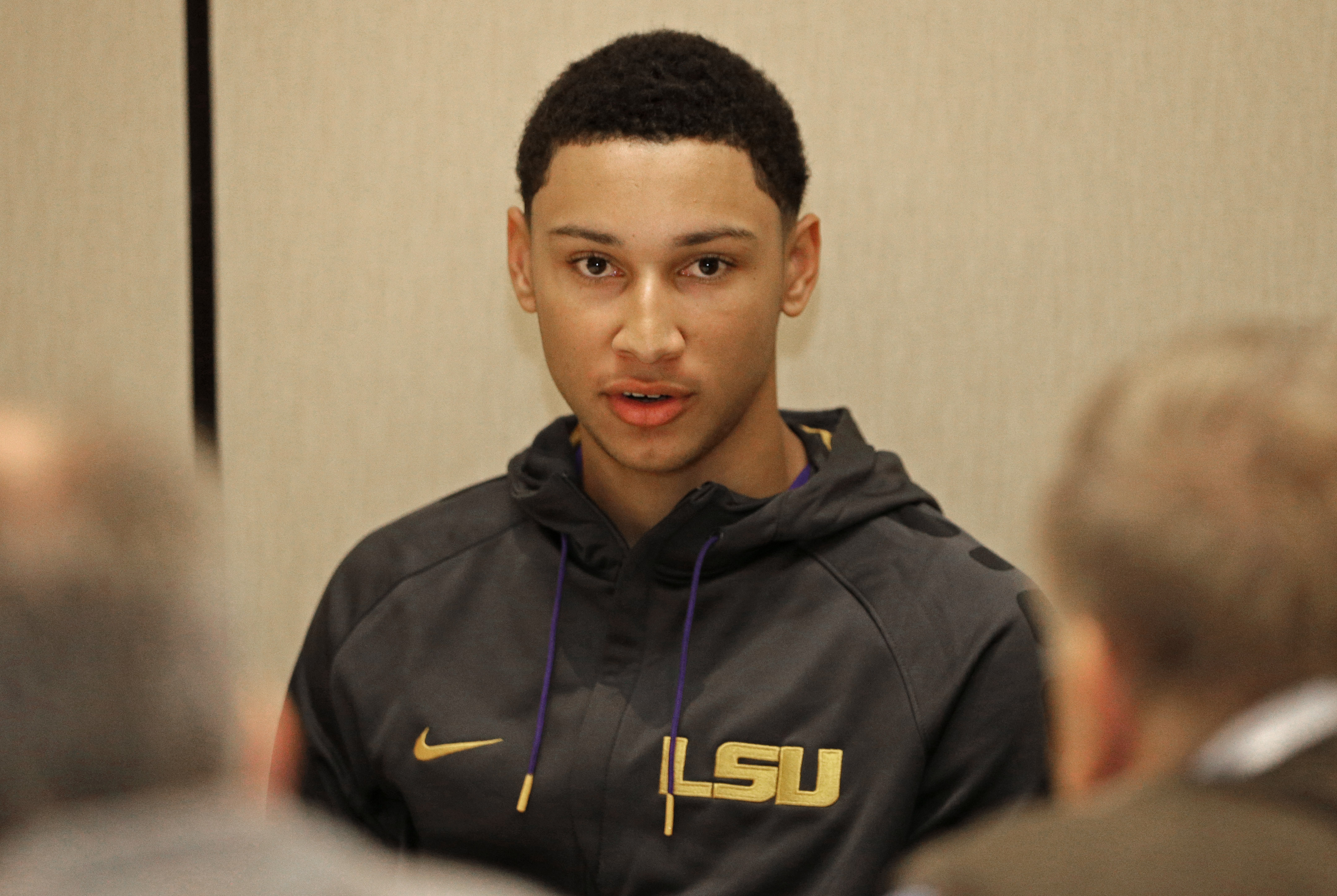 FILE - In this Oct. 21, 2015, file photo, Louisiana State's Ben Simmons answers a question during the Southeastern Conference men's  NCAA college basketball media day in Charlotte, N.C. The blue bloods have reloaded. New contenders are rising. More talent