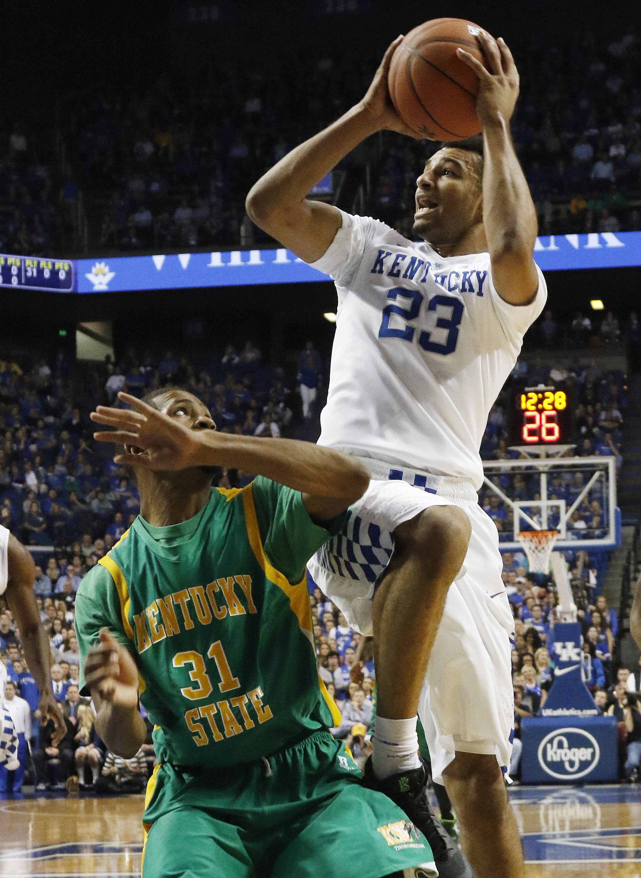 Kentucky's Jamal Murray (23) shoots over the defense of Kentucky State's Michael Cross (31) during an NCAA college basketball exhibition game Friday, Nov. 6, 2015, in Lexington, Ky. (AP Photo/James Crisp)