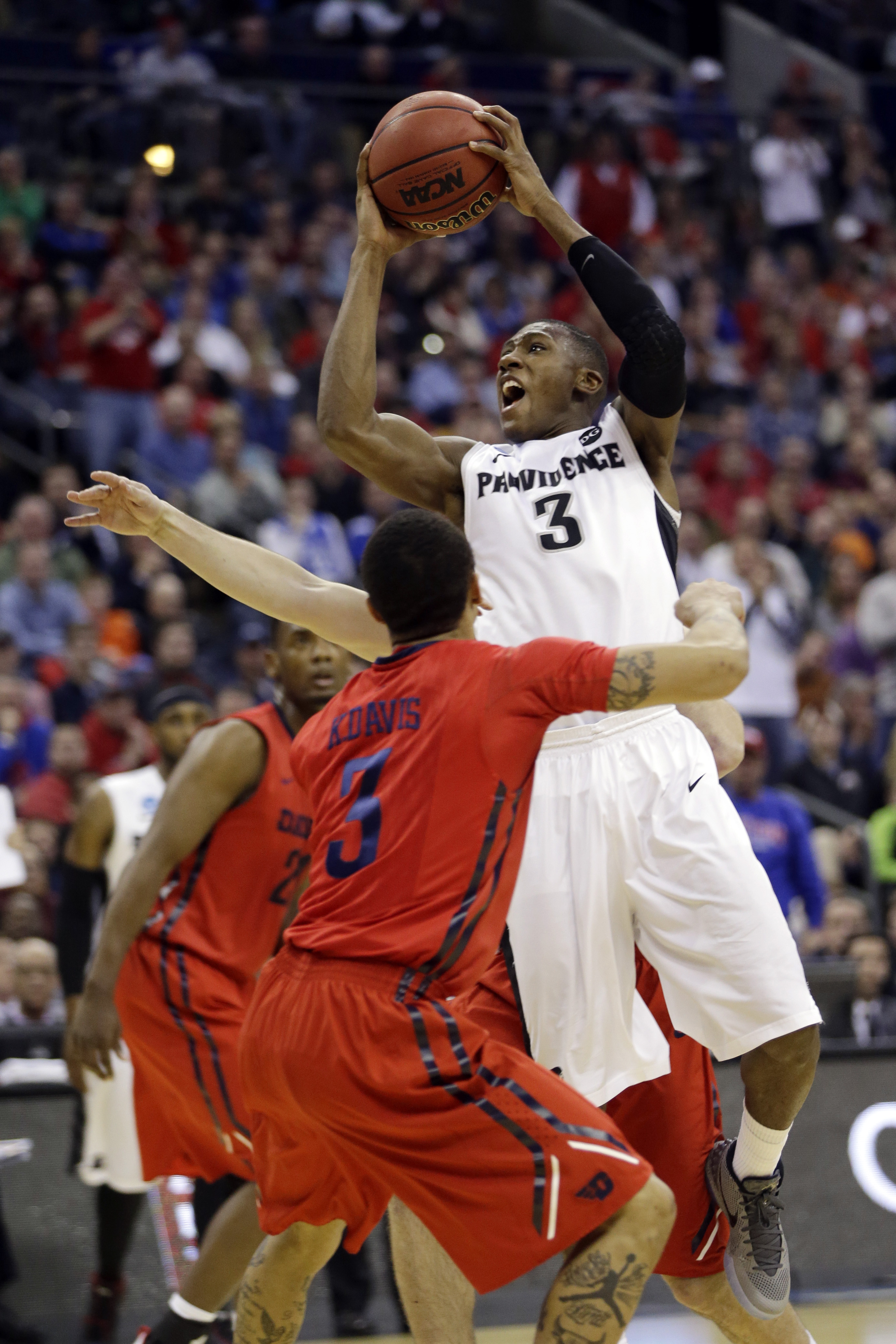 FILE - In this March 20, 2015, file photo, Providence's Kris Dunn (3) shoots against Dayton in the first half of an NCAA tournament college basketball game in the Round of 64 in Columbus, Ohio. Dunn was selected to The Associated Press preseason All-Ameri