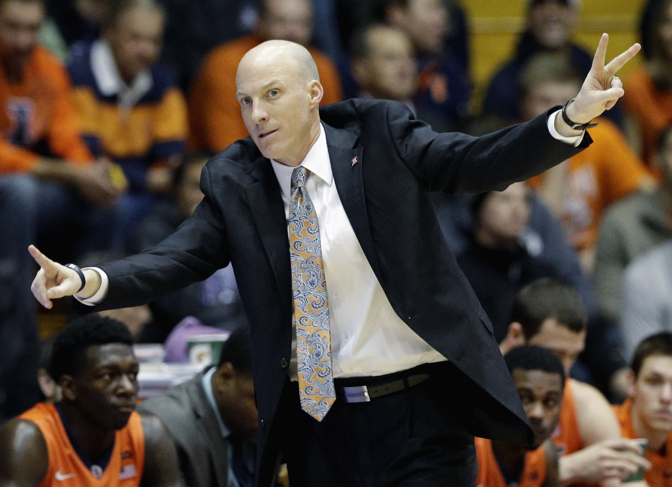 FILE - In this Jan. 14, 2015, file photo, Illinois head coach John Groce gives instructions to his players during an NCAA college basketball game against Northwestern in Evanston, Ill. There were no fewer than 40 coaching changes in men's Division I baske