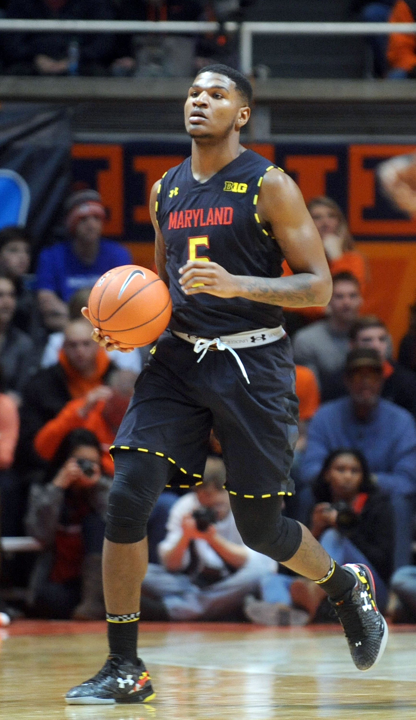 Maryland's Dion Wiley (5) dribbles during the second half of an NCAA college basketball game between Maryland and Illinois at State Farm Center  in Champaign, IL on Wednesday, Jan. 7, 2015. (AP Photo/Heather Coit)