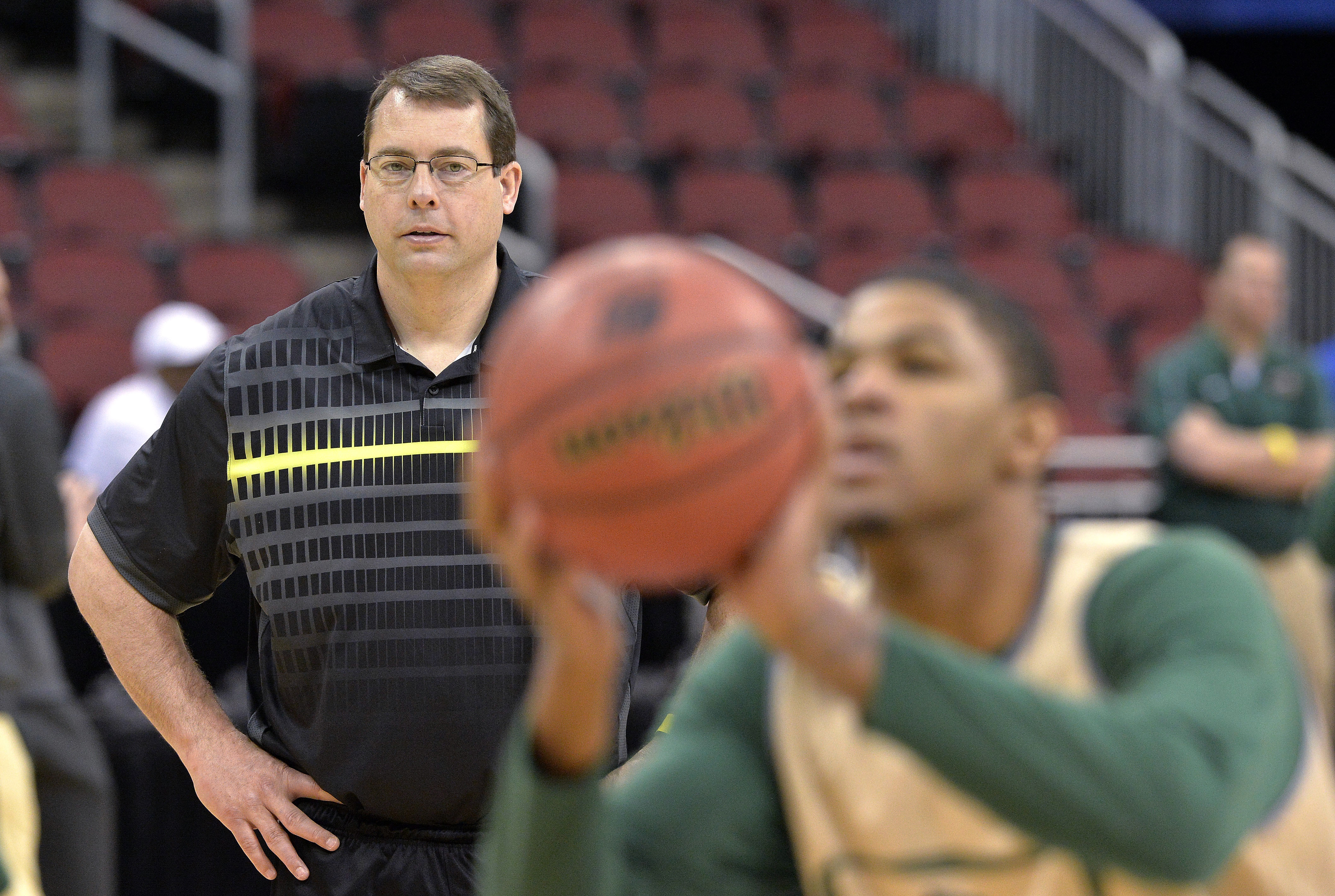 FILE - In this March 18, 2015, file photo, UAB head coach Jerod Haase, left, watches as his team practices for an NCAA college basketball tournament game in Louisville, Ky. Haase is using part of his new seven-figure contract to help cover the cost of att