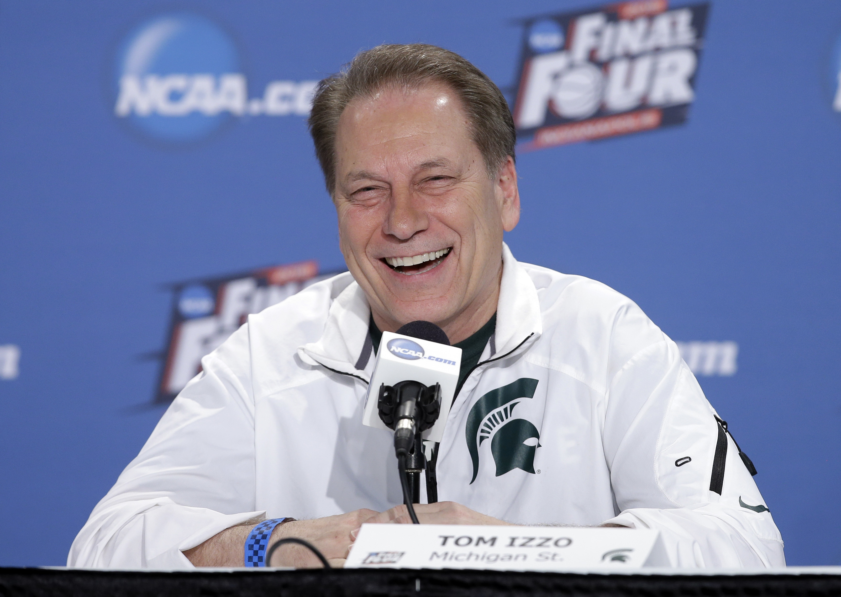 FILE - In this April 2, 2015, file photo, Michigan State head coach Tom Izzo smiles during a news conference for the NCAA Final Four tournament college basketball semifinal game, in Indianapolis. Tom Izzo has joined an exclusive club of college basketball