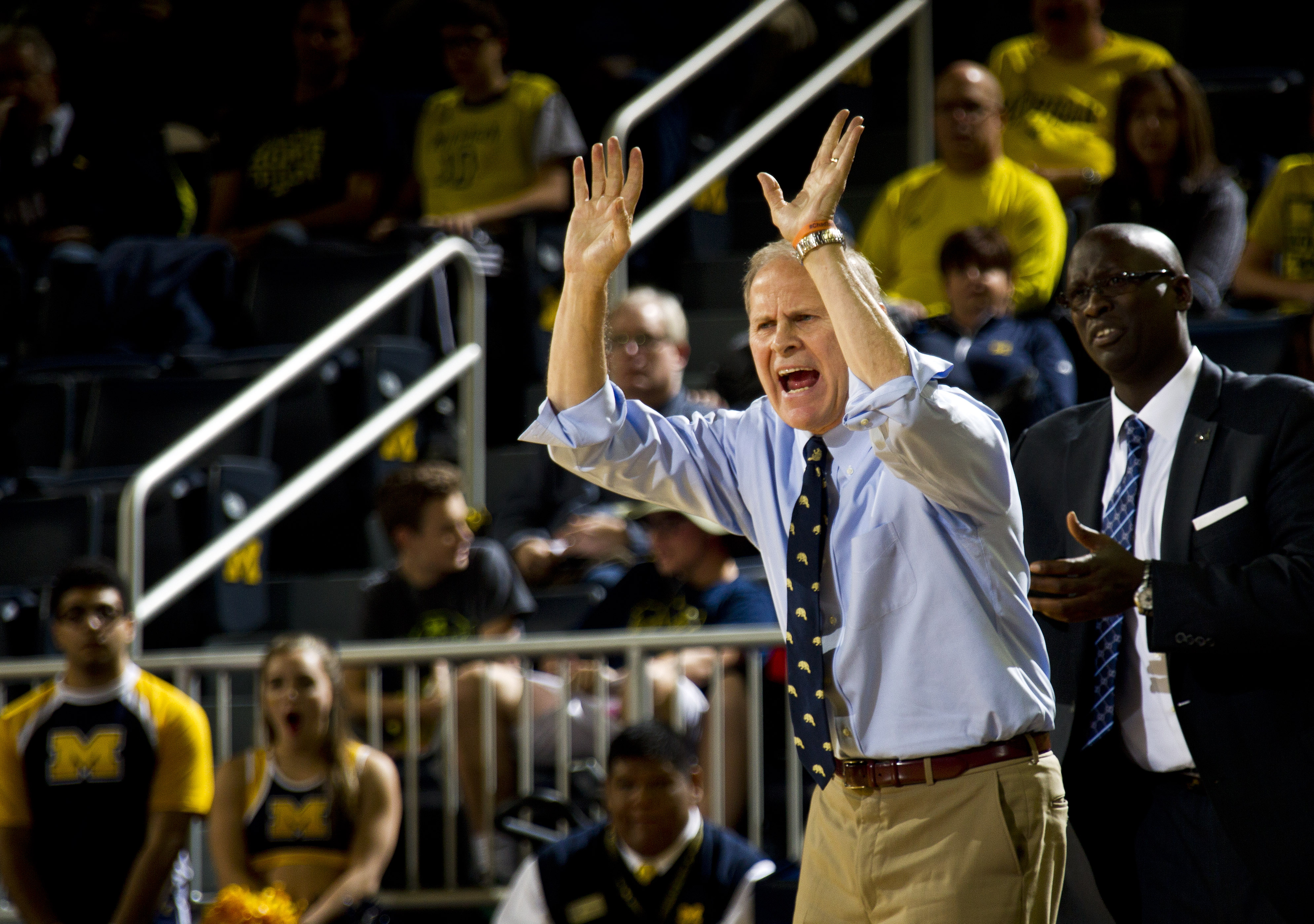 Michigan head coach John Beilein, left, reacts from courtside in the first half of an NCAA college basketball game against Northern Michigan at Crisler Center in Ann Arbor, Mich., Friday, Nov. 13, 2015. (AP Photo/Tony Ding)