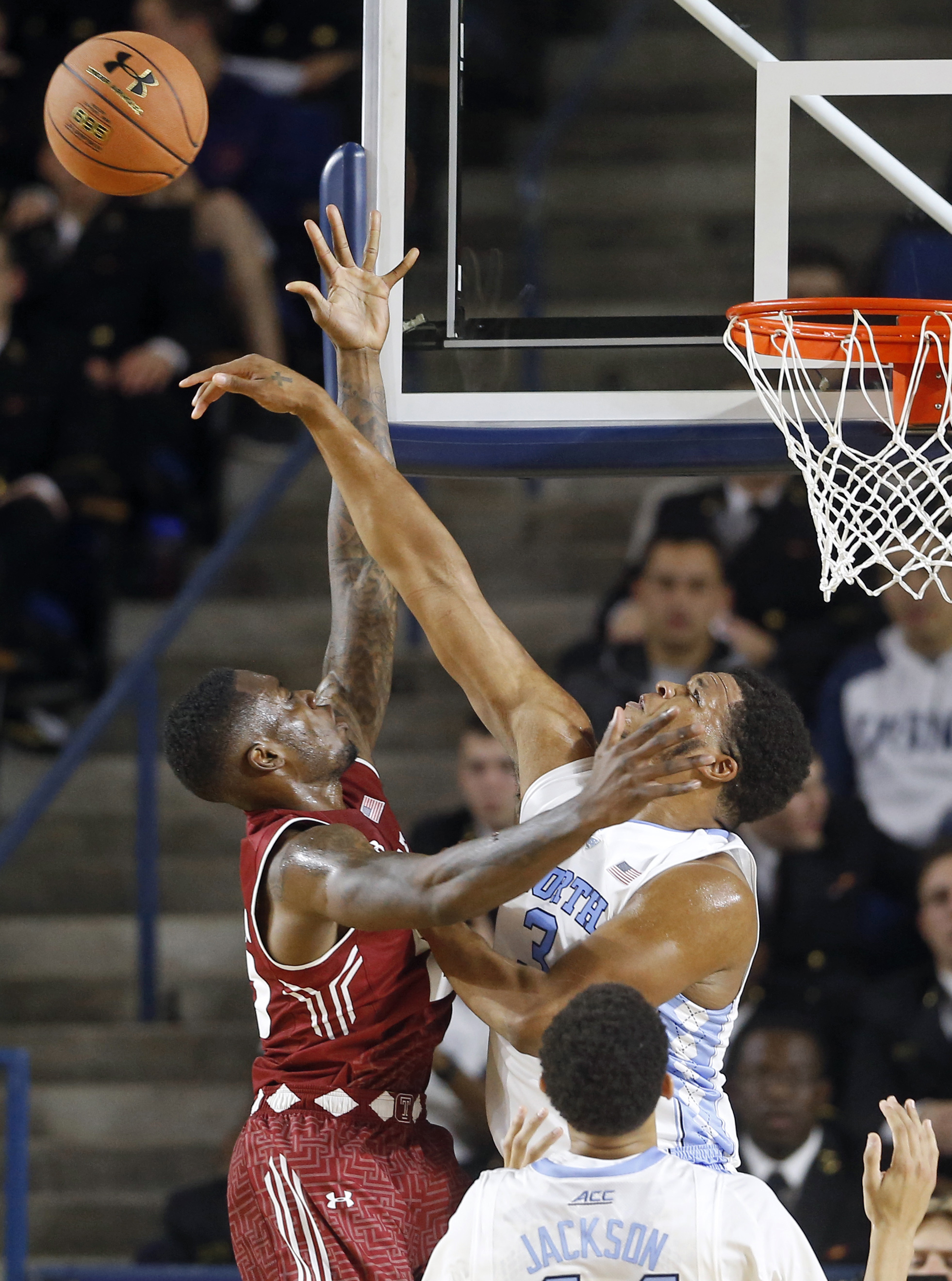 North Carolina forward Kennedy Meeks, right, blocks a shot attempt by Temple guard Quenton DeCosey in the first half of a Veterans Classic NCAA college basketball game, Friday, Nov. 13, 2015, in Annapolis, Md. (AP Photo/Patrick Semansky)