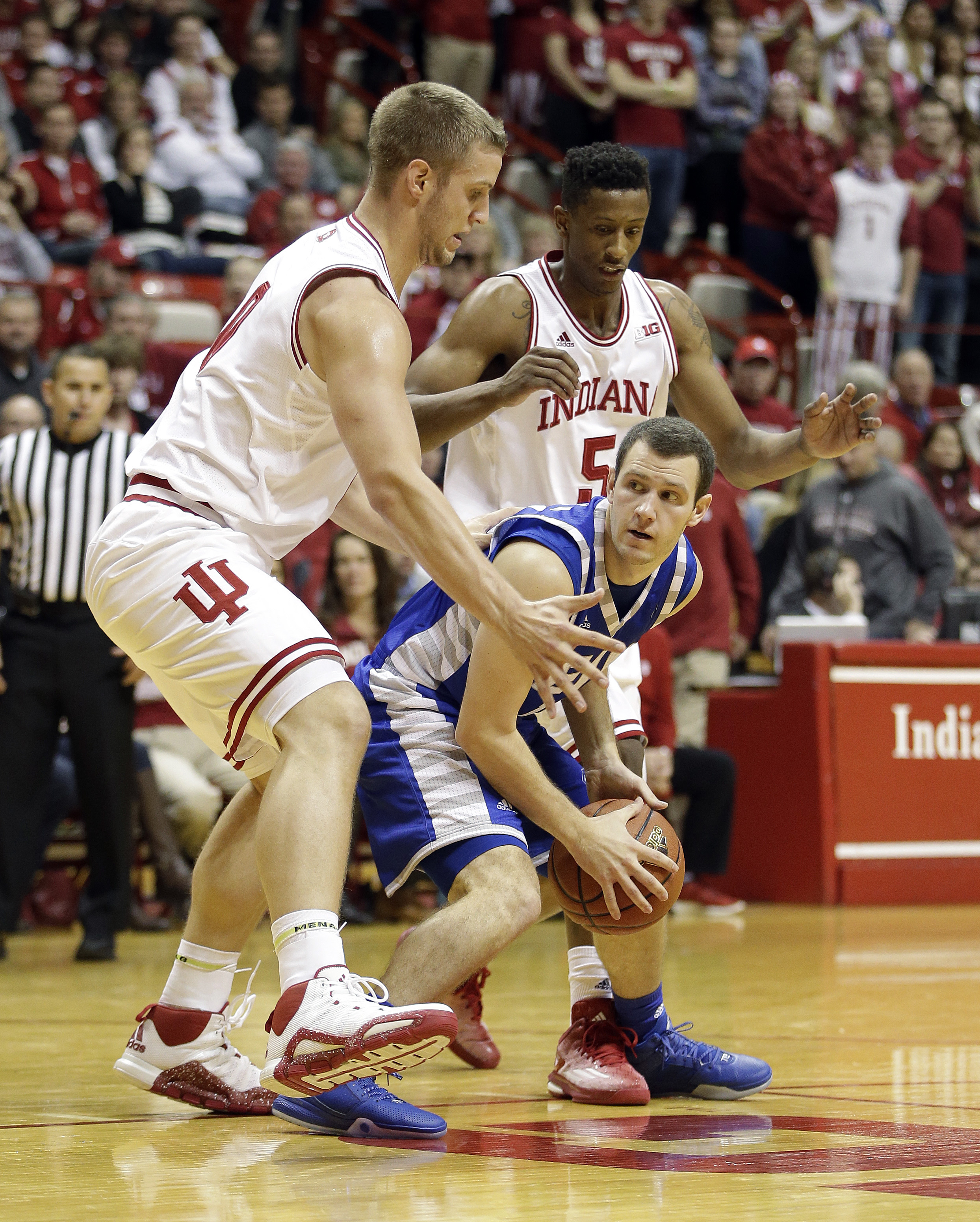 Eastern Illinois' Luke Norman (10) is defended by Indiana's Max Bielfeldt, left, and Troy Williams during the first half of an NCAA college basketball game Friday, Nov. 13, 2015, in Bloomington, Ind. (AP Photo/Darron Cummings)