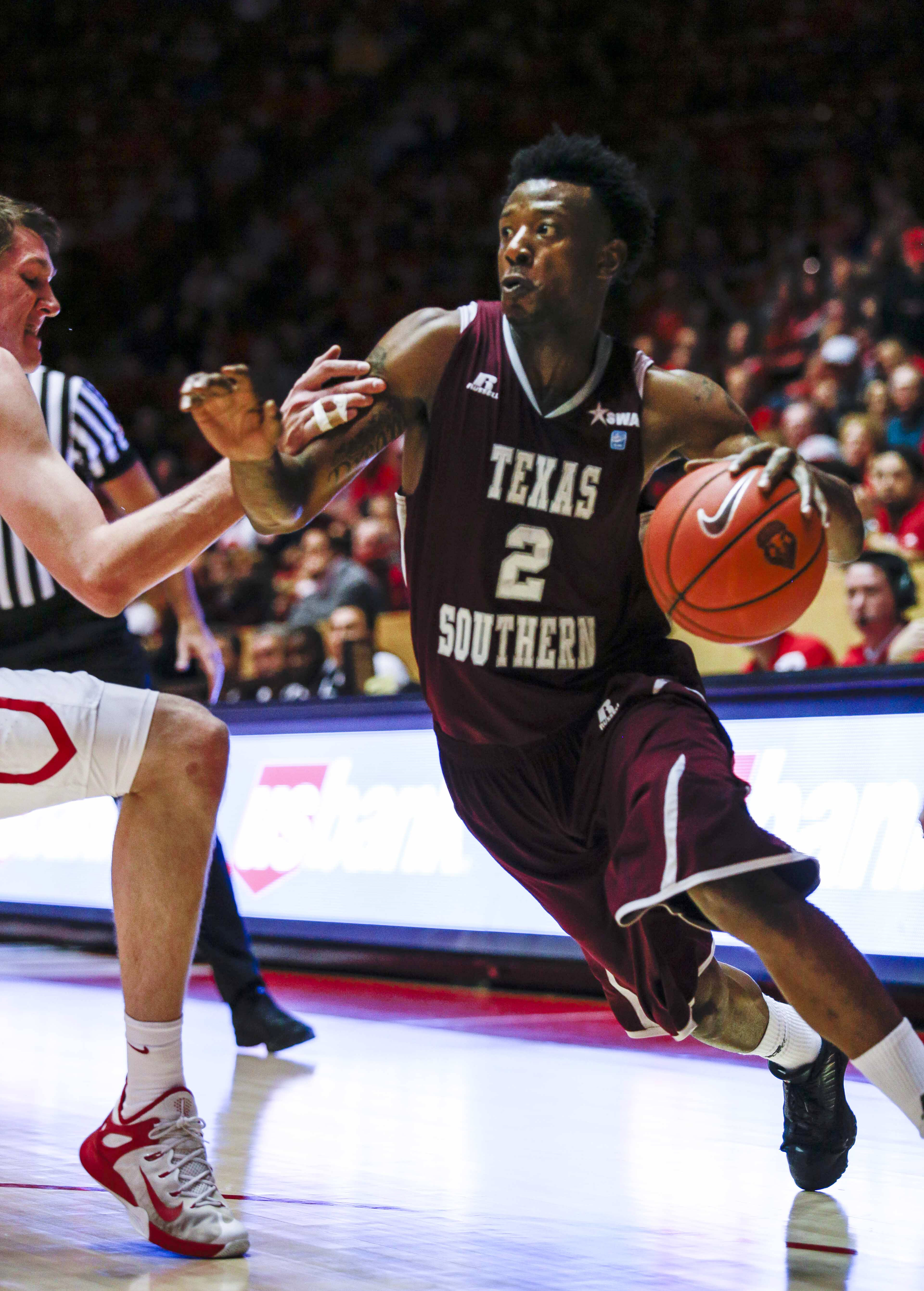 Texas Southern's Chris Thomas (2) drives against a New Mexico defender during the first half an NCAA college basketball game, Friday, Nov. 13, 2015, in Albuquerque, N.M. (AP Photo/Juan Labreche)