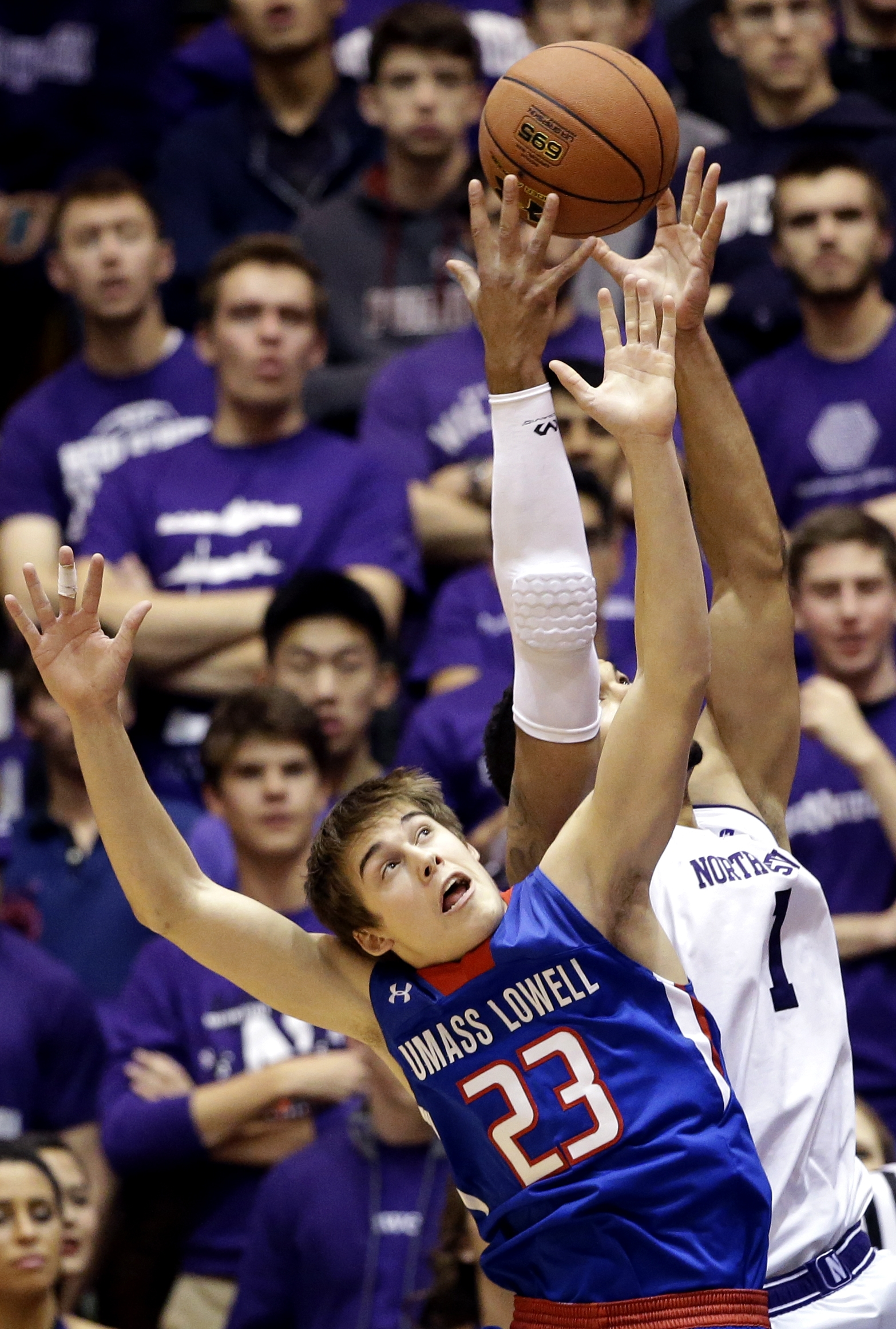 UMass-Lowell guard/forward Logan Primerano, left, and Northwestern center Joey van Zegeren battle for a rebound during the first half of an NCAA college basketball game Friday, Nov. 13, 2015, in Evanston, Ill. (AP Photo/Nam Y. Huh)