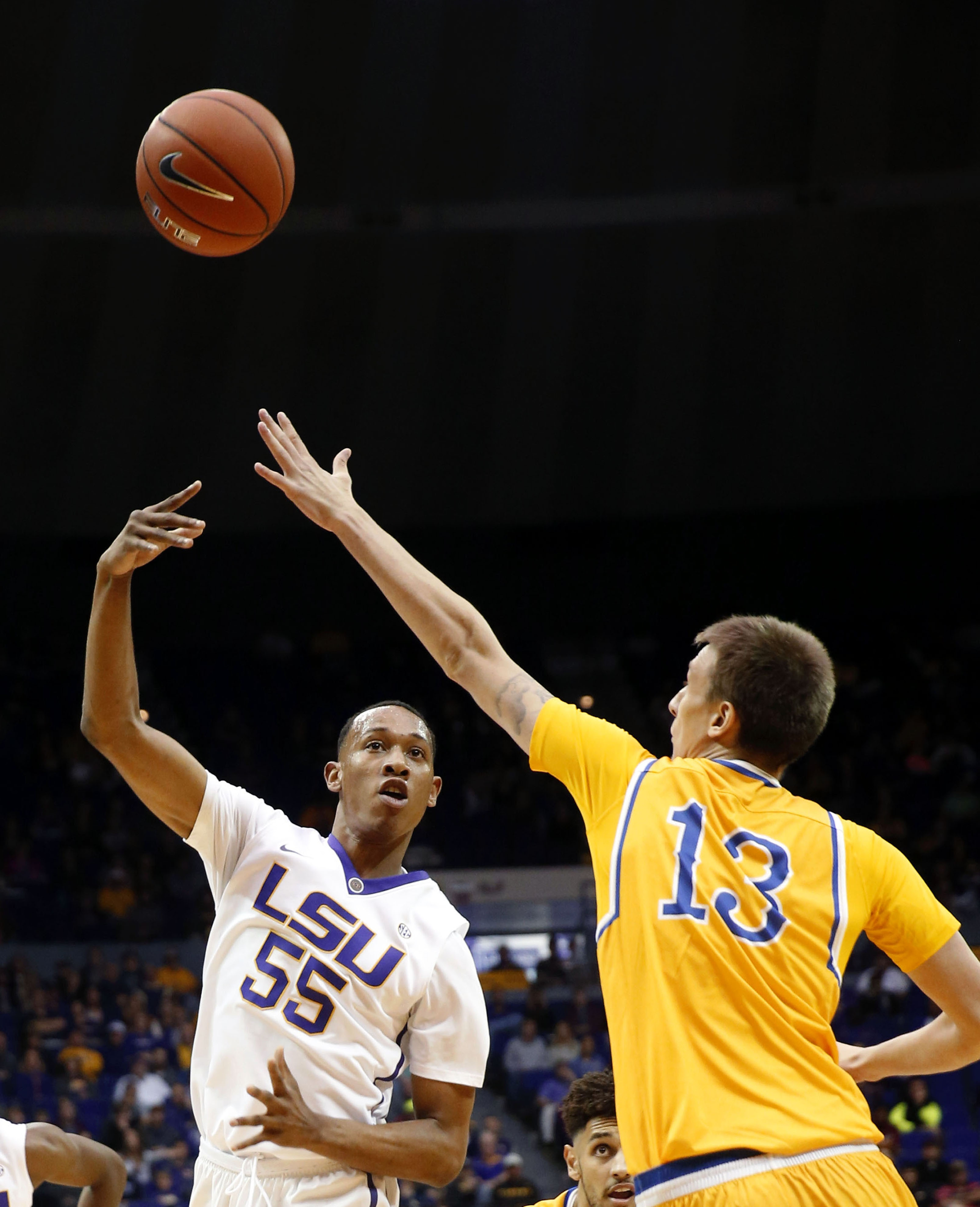 LSU guard Tim Quarterman (55) passes against McNeese State center Matthew Moss (13) in the first half of an NCAA college basketball game in Baton Rouge, La., Friday, Nov. 13, 2015. (AP Photo/Gerald Herbert)