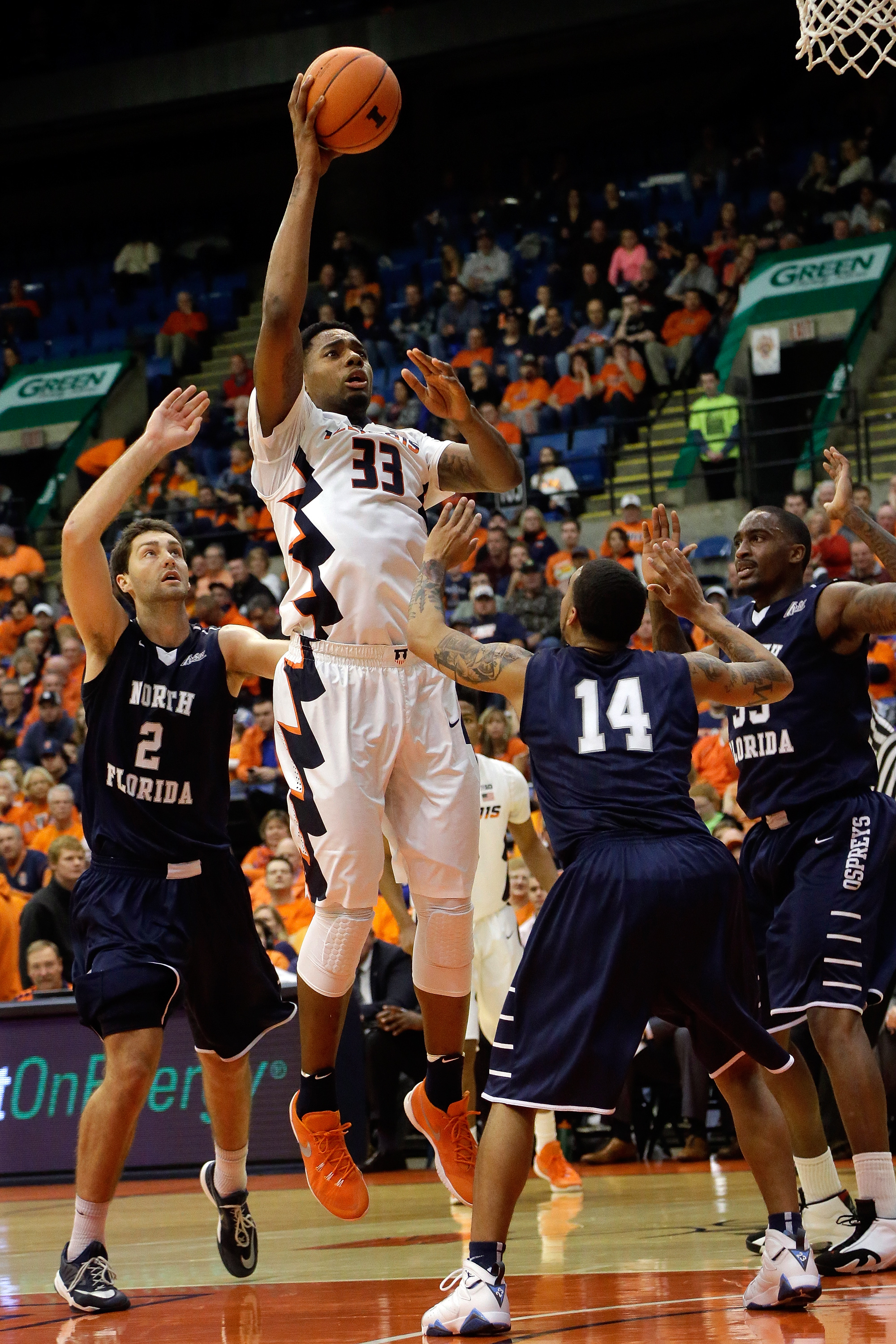 Illinois forward Mike Thorne Jr. (33) shoots over North Florida guard Dallas Moore (14) during the first half of an NCAA  college basketball game at the Prairie Capital Convention Center Friday, Nov. 13, 2015, in Springfield, Ill. (AP Photo/Seth Perlman)