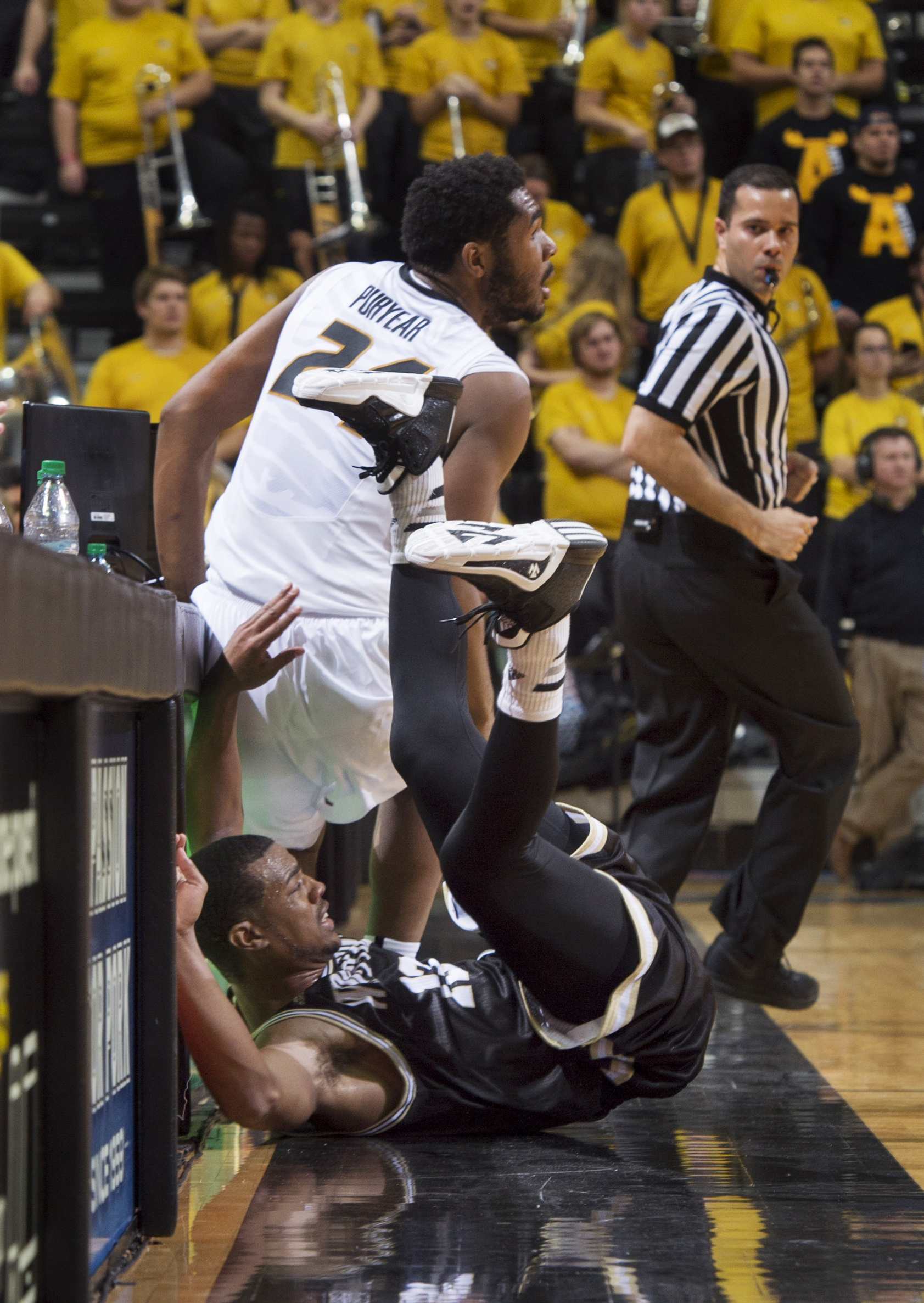 Wofford's Spencer Collins, bottom, falls out of bounds as he collides with Missouri's Kevin Puryear, top, as the scrambled for a loose ball during the first half of an NCAA college basketball game Friday, Nov. 13, 2015, in Columbia, Mo. (AP Photo/L.G. Pat
