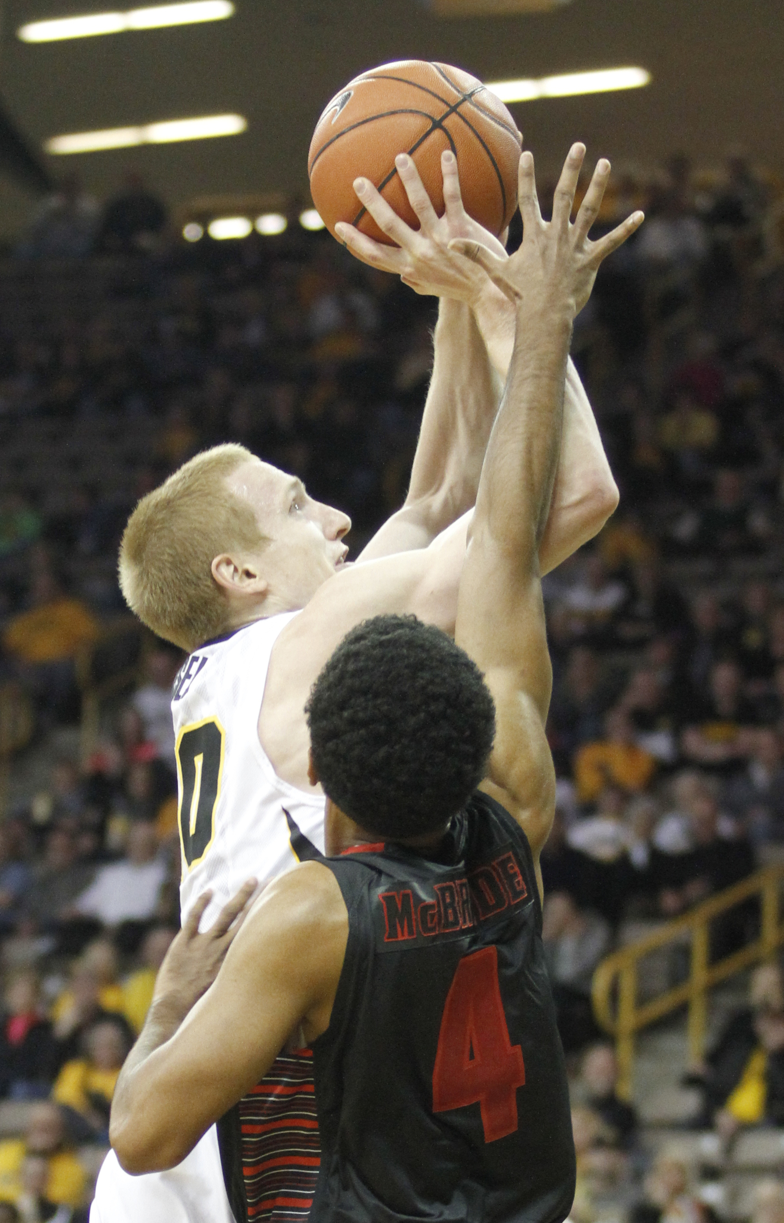 Iowa guard Mike Gesell (10) drives to the basket against Gardner-Webb guard Harold McBride (4) during the first half of an NCAA college basketball game in Iowa City, Iowa, Friday, Nov. 13, 2015. (AP Photo/Matthew Holst)